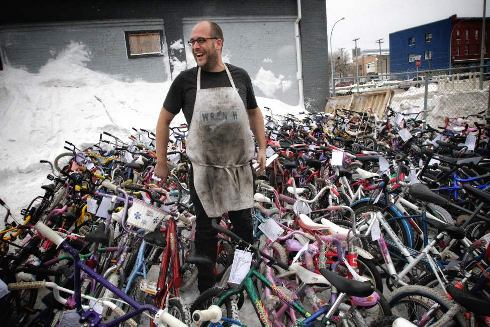 Pat Krawec, Executive Director at The Wrench, a bicycle repair education and cycling hub, stands among the finished bikes during the Cycle of Giving at the Atomic Centre on Logan Avenue. Dozens of mechanics have been working for the last 24 hours, fixing up over 200 bicycles for Winnipeg children in need in the second annual event.   Sunday, December 16, 2012.  (MIKE DEAL / WINNIPEG FREE PRESS)