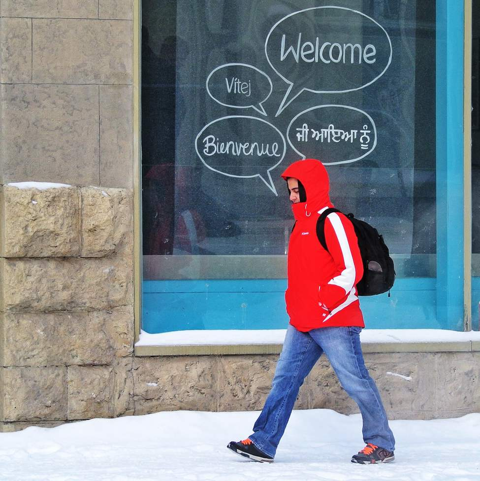 Not exactly welcome weather! Red River College student Juan Bonilla walks by window sign on Princess Street in Winnipeg's Exchange District over the lunch hour as the temperature hit the expected low of the day at -20C. February 05, 2013 (Mike Deal / Winnipeg Free Press)