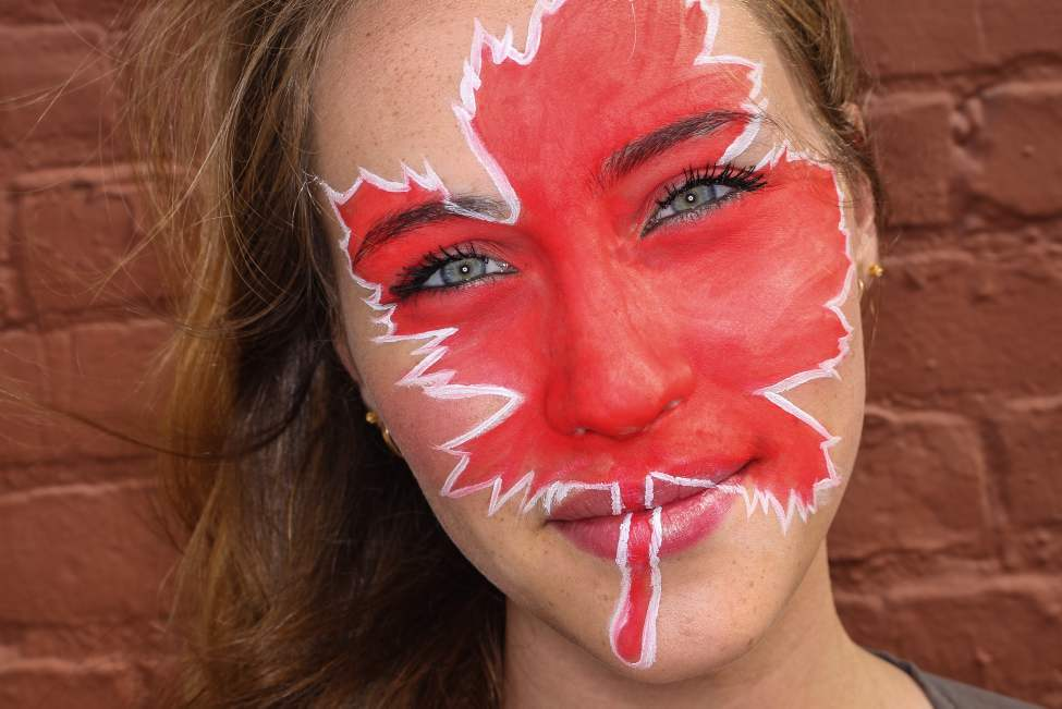 Issy Dahl with a maple leaf painted on her face for a Canada Day feature. (MIKE DEAL / WINNIPEG FREE PRESS)