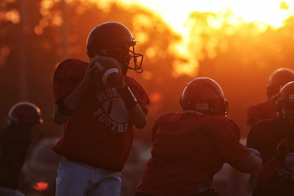 Members of the Mustangs Peewee White (10-12 yrs-old) team practice at Maple Grove Park Thursday as the sun sets, preparing for their Saturday regular season game at the park. August 15, 2013 (Mike Deal / Winnipeg Free Press)