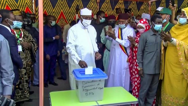 In this Sunday, April 11, 2021 image made from video, Chadian President Idriss Deby Itno, center, casts his vote in the recent elections in N'Djamena, Chad. Deby, who ruled the central African nation for more than three decades, was killed on the battlefield Tuesday, April 20, 2021 in a fight against rebels, the military announced on national television and radio. (AP Photo)