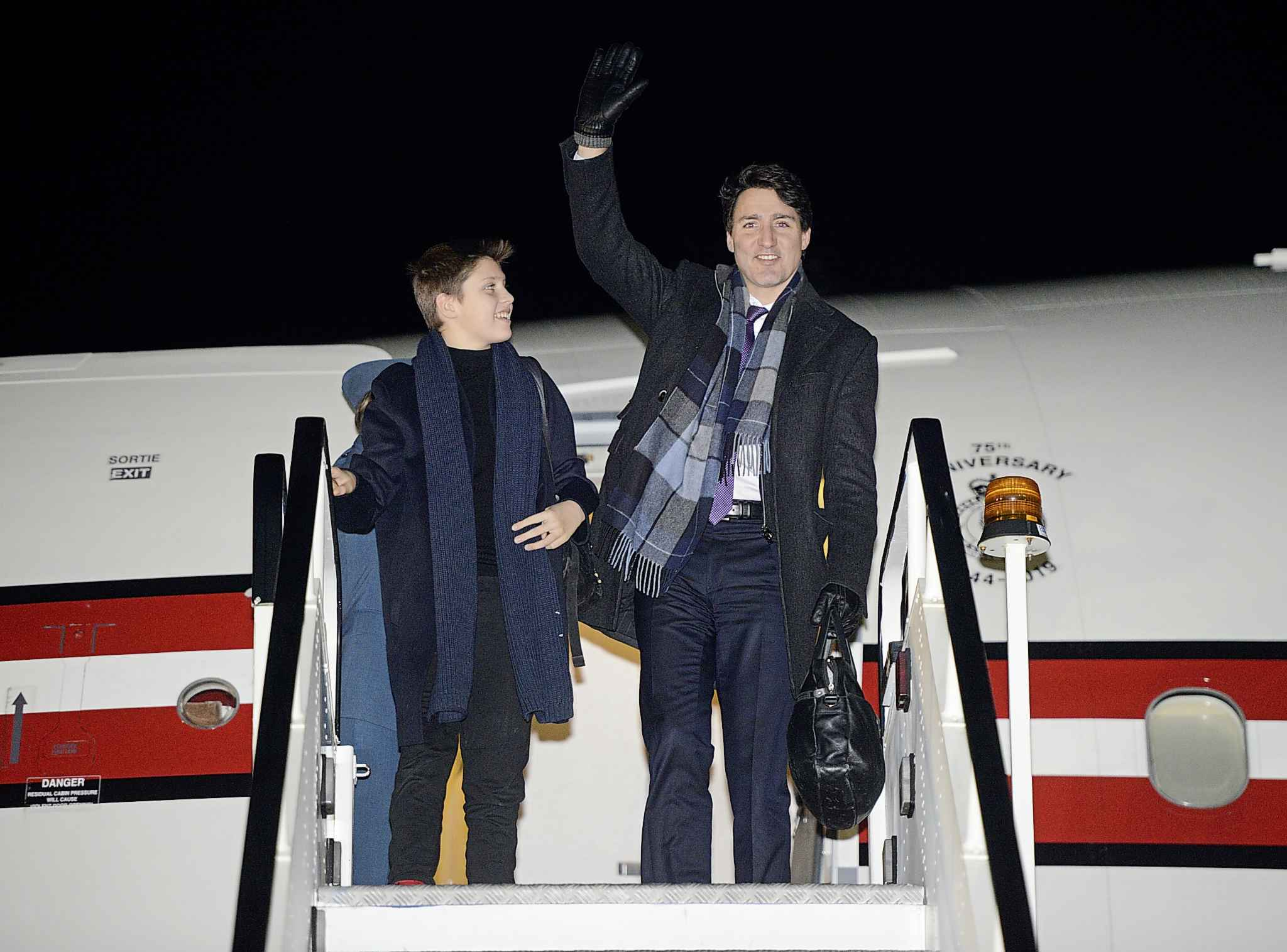 Canadian Prime Minister Justin Trudeau and son Xavier arrive in London for the 2019 NATO summit.