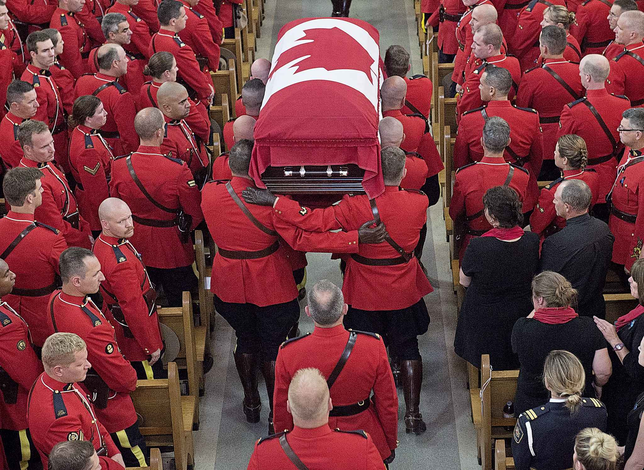 Pall Bearers carry the coffin at the regimental funeral for RCMP Const. Francis Deschenes in Moncton, N.B. on Wednesday, Sept. 20, 2017. Deschenes was killed after he stopped to help a motorist change a tire and a cargo van slammed into his cruiser.