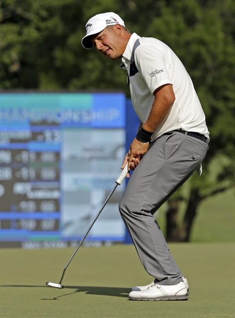 Freddie Jacobson, of Sweden, reacts as he misses a birdie putt on the 18th hole during the third round of the Wyndham Championship golf tournament in Greensboro, N.C., Saturday, Aug. 16, 2014. (AP Photo/Chuck Burton)