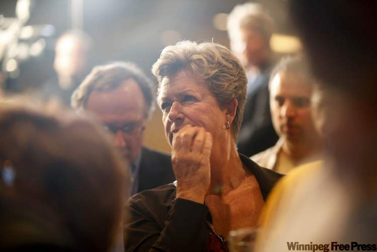 An NDP party supporter looks concerned as she watches the results at the NDP party headquarters at the Convention Centre on election night.