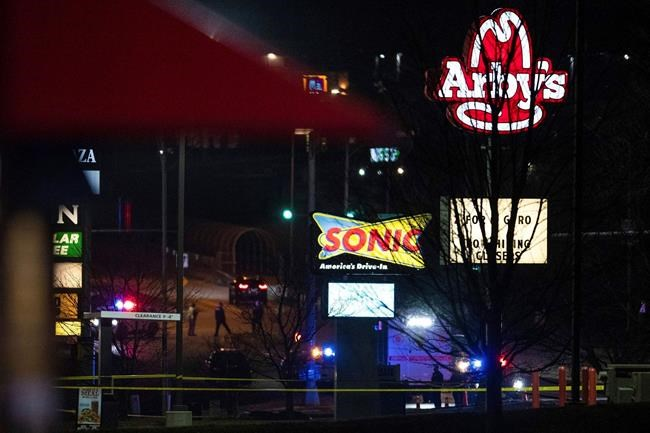 This Sunday, Nov. 22, 2020 photo shows emergency personnel on the scene after a shooting at a Sonic restaurant on Saturday night where two people were killed and two others wounded in Bellevue, Neb. (Anna Reed/Omaha World-Herald via AP)