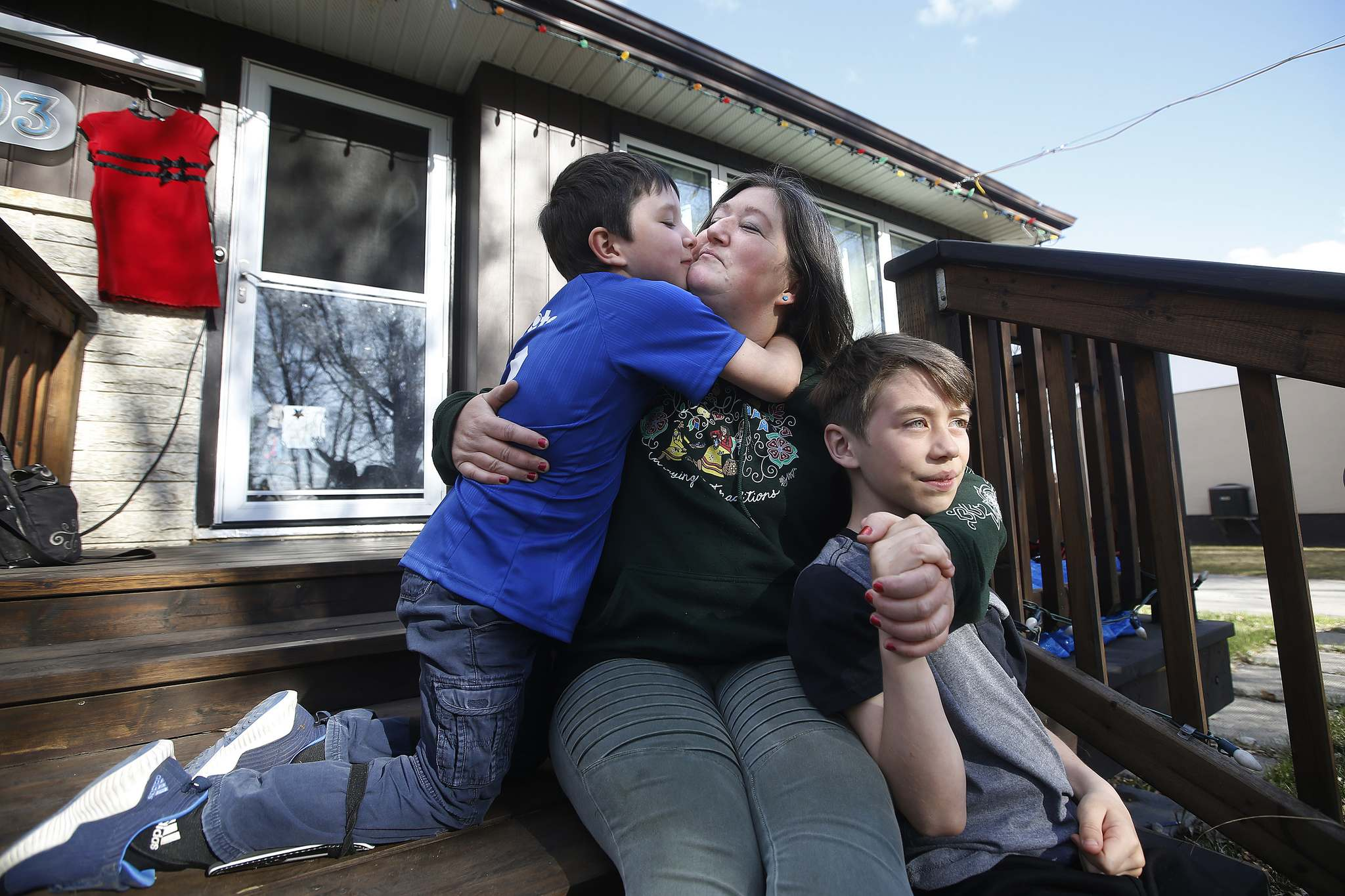 Kisa MacIsaac spends time with her sons Kalvin, left, and Oren before Kalvin's soccer game.</p></p>