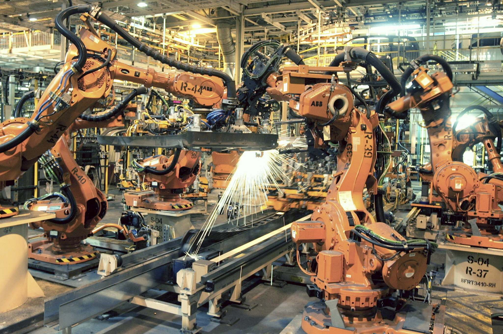Jerry S. Mendoza / The Associated Press files</p><p>Robots such the ones seen here on an automotive assembly line have replaced many factory work jobs.</p>