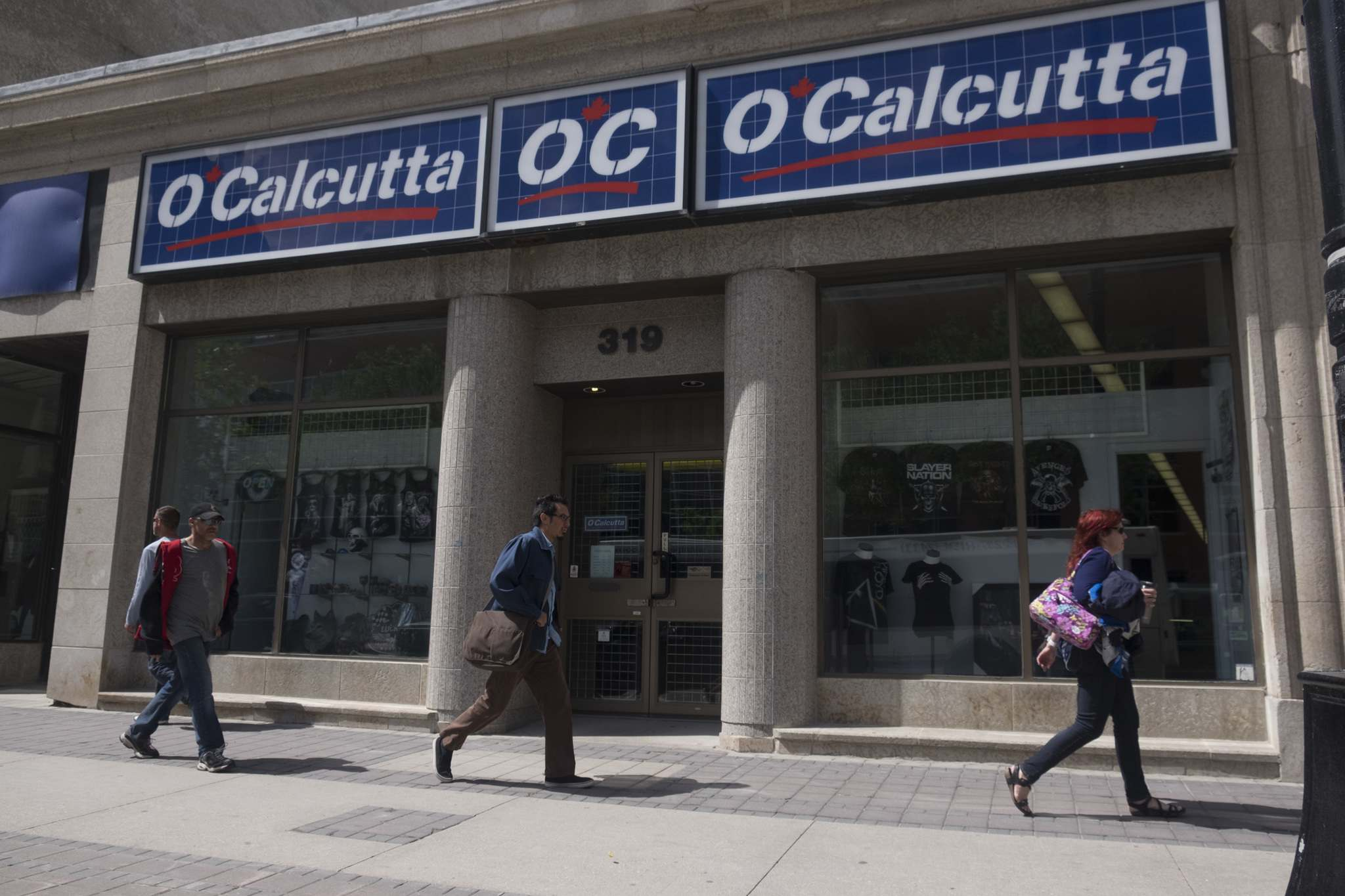 ZACHARY PRONG / WINNIPEG FREE PRESS</p><p>People pass by O Calcutta on the north side of Portage Avenue., one of the longest-running family businesses in the area. </p>