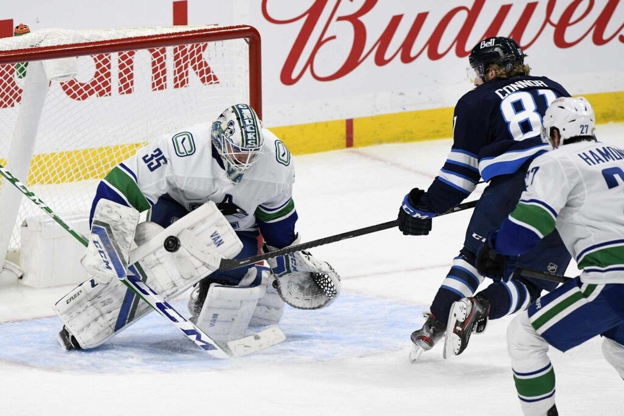 Vancouver Canucks goaltender Thatcher Demko makes one of his 39 saves on the Winnipeg Jets Monday as he stops Kyle Connor during a third-period breakaway. THE CANADIAN PRESS/Fred Greenslade</p>