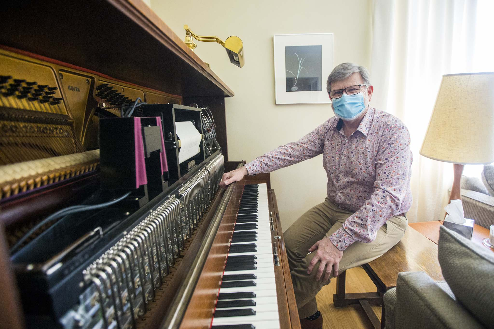 photos by MIKAELA MACKENZIE / WINNIPEG FREE PRESS</p><p>Andrew Thomson with a player piano in his East Kildonan home. The collector and restorer has nurtured a passion for the 'pianola' since childhood.</p></p>
