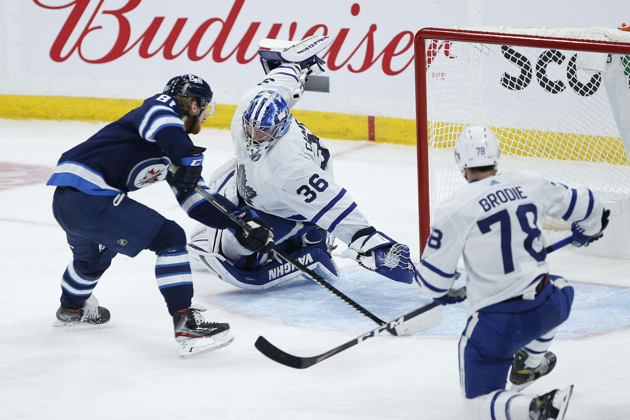 Kyle Connor scores on the backhand against Jack Campbell in the second. (John Woods / The Canadian Press)