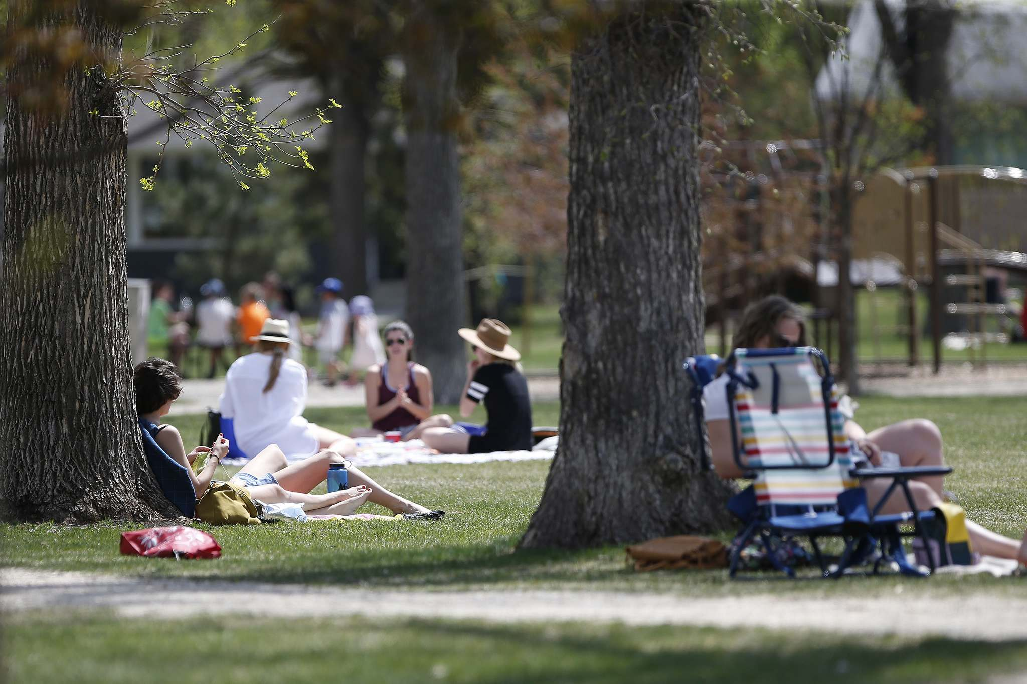 People relax at Enderton (Peanut) Park in Winnipeg on Sunday. People having been heading to the parks because of increased COVID-19 restrictions.