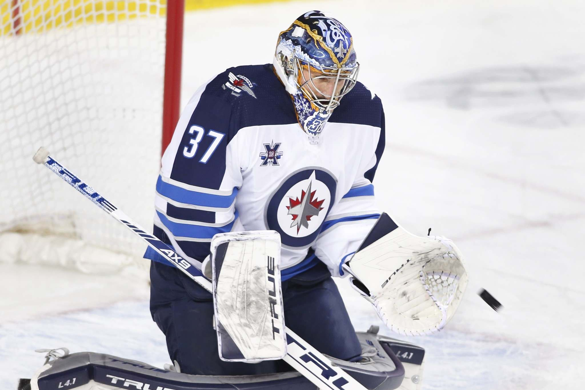 Winnipeg Jets goalie Connor Hellebuyck is entering the post-season on a high note, having won his last two regular-season starts and three of the four games he's played in May.  (Larry MacDougal / Canadian Press files)