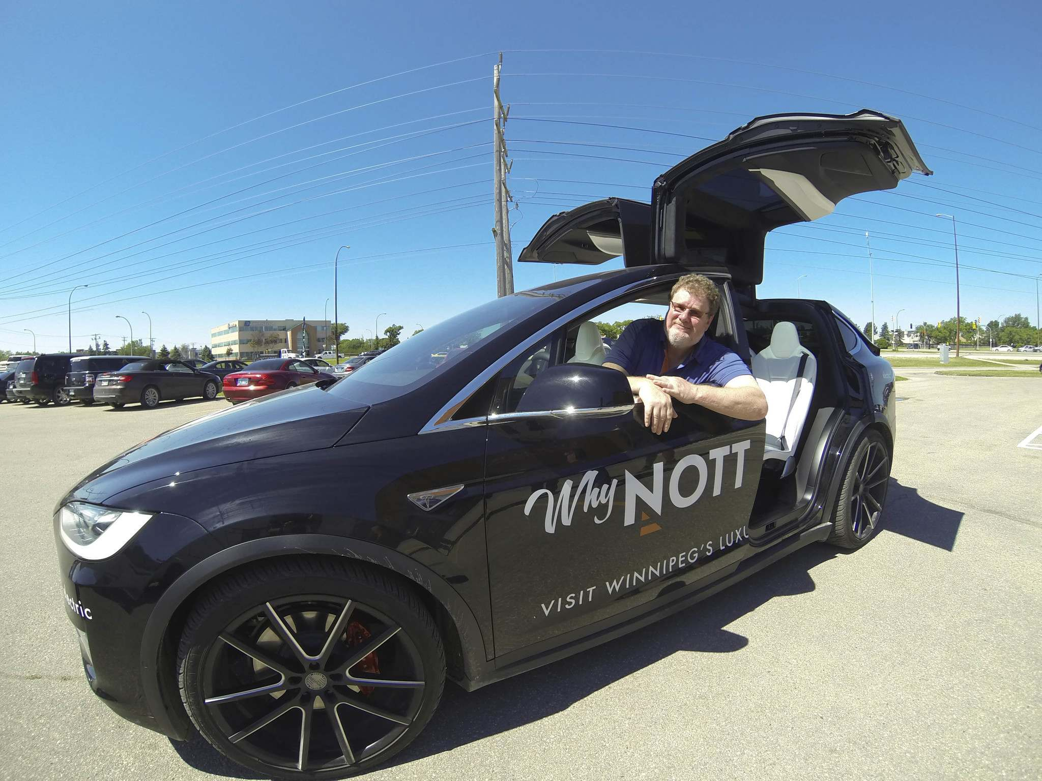 Tyler Walsh / Winnipeg Free Press Free Press</p><p>humour columnist Doug Speirs sits in the 2015 Tesla Model X at Nott Autocorp. The fully electric Tesla vehicle features autopilot mode which allows drivers to hand over control to the vehicle.</p>