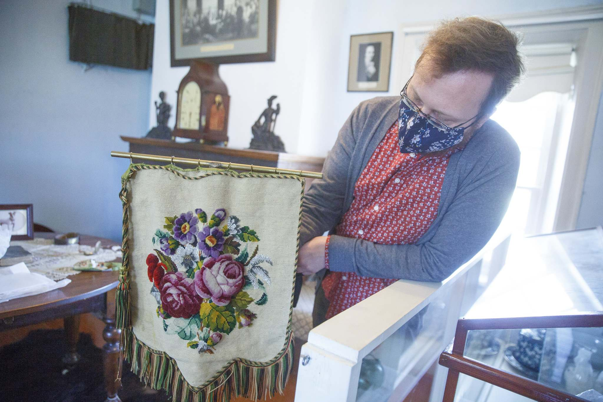 A fire screen made with bead and wool embroidery from the late 19th century on display. (Mike Deal / Winnipeg Free Press)</p>