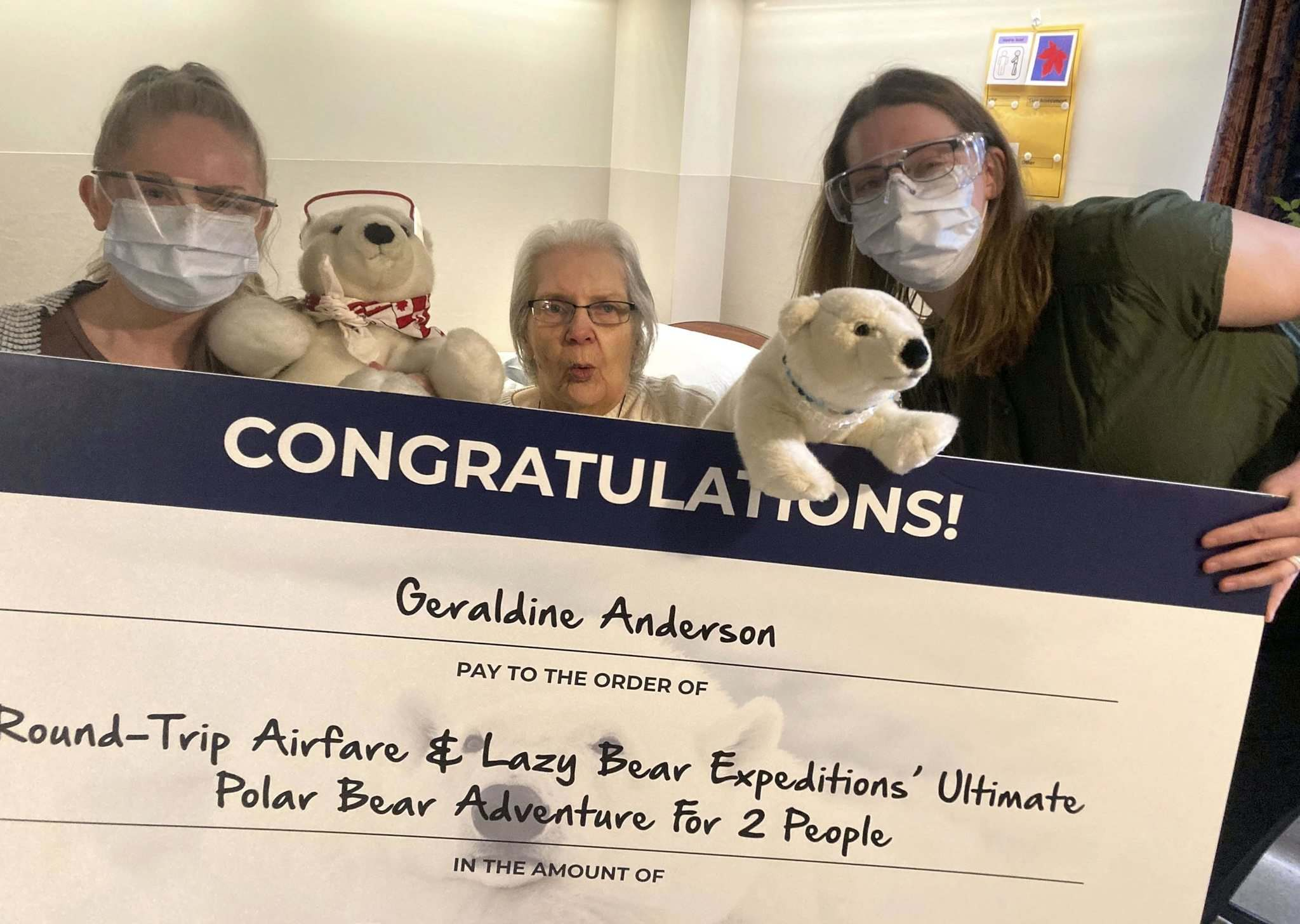 SUPPLIED</p><p>At Misericordia Place, recreation facilitator Rael Kulchycki (left) and recreation manager Jennifer Klos flank resident Geraldine Anderson with her 'cheque' for a polar bear trip to Churchill.</p>