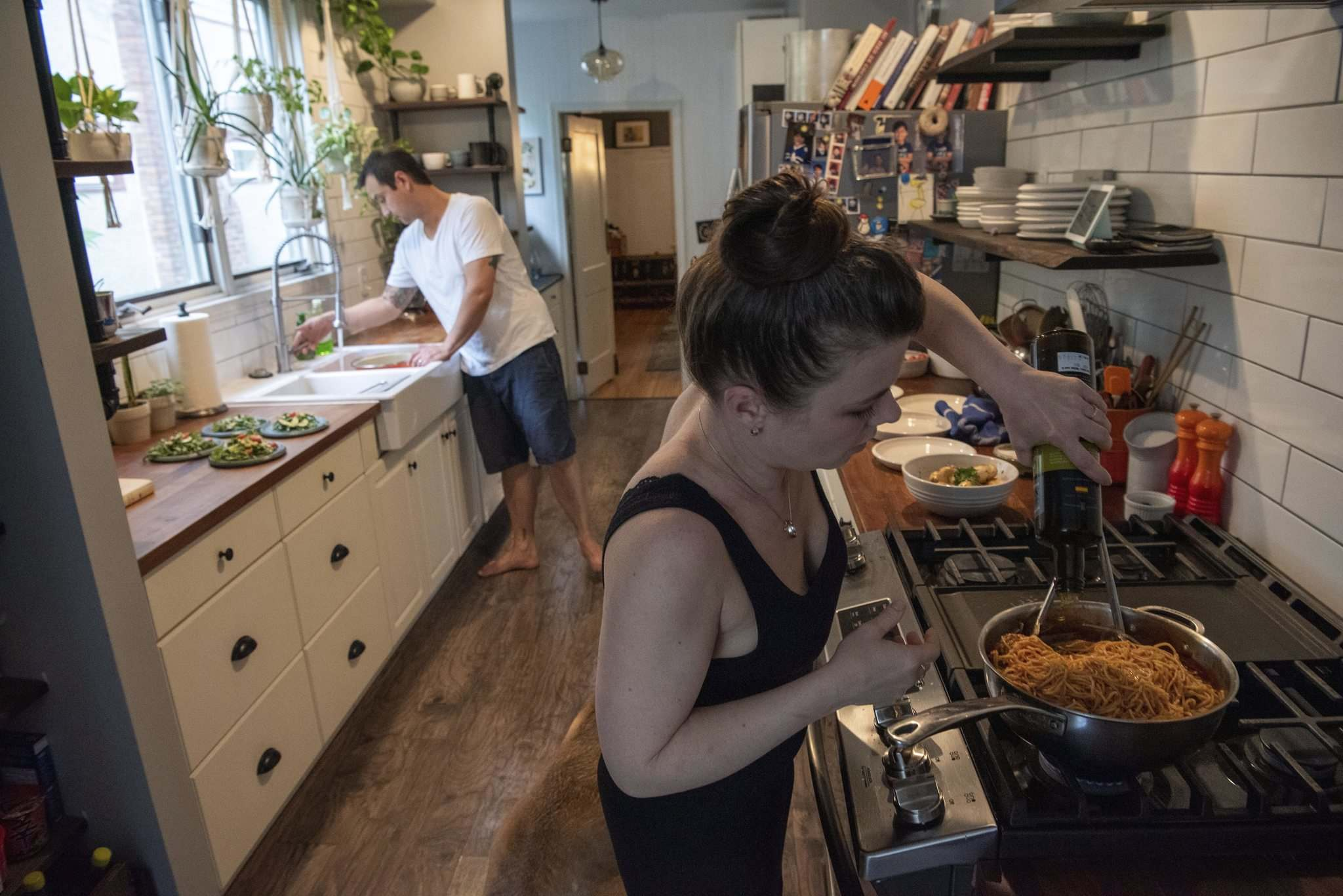 photos by ALEX LUPUL / WINNIPEG FREE PRESS</p><p>Kristen Chemerika-Lew, right, and Kyle Lew are a culinary team in their home kitchen and at their Exchange District resto, Lark.</p>