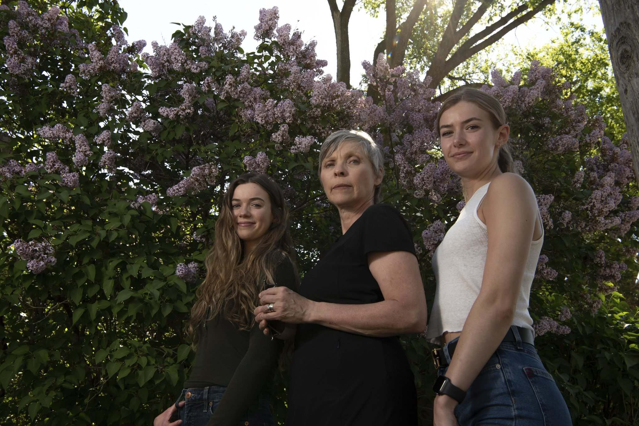 Spooky crew: Local actors Megan Best (from left), Marina Stephenson Kerr and Jade Michael, stars of the film Seance, outside the Wellington Crescent home that was used as a location the movie. (Alex Lupul / Winnipeg Free Press)