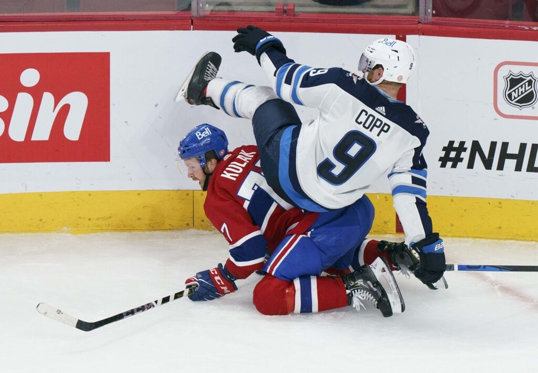 Winnipeg Jets' Andrew Copp falls on Montreal Canadiens' Brett Kulak during the second period. THE CANADIAN PRESS/Paul Chiasson</p>