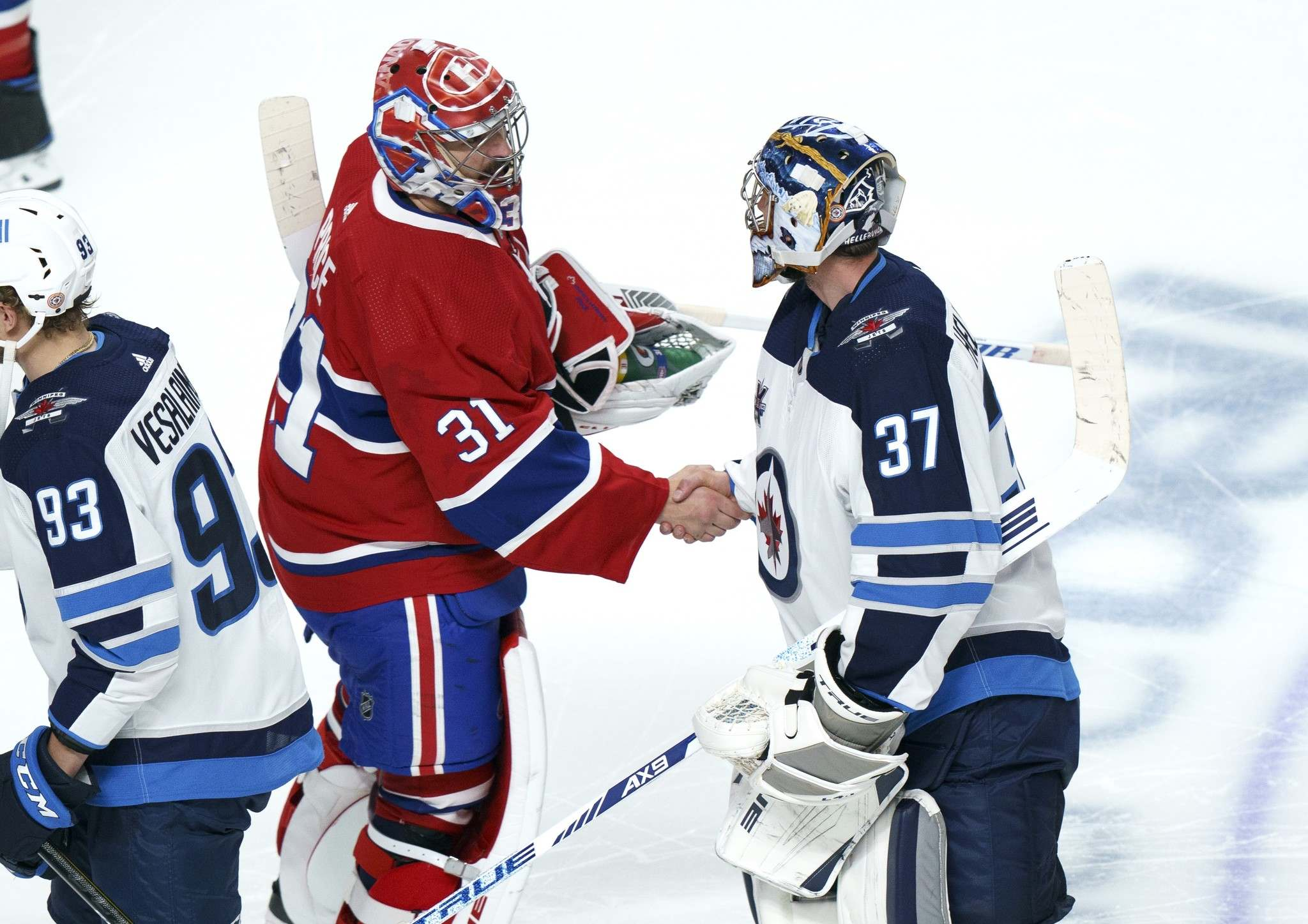 Montreal Canadiens goaltender Carey Price shakes hands with his Winnipeg Jets counterpart Connor Hellebuyck after the Jets were knocked out of the playoffs to end their season. (Paul Chiasson / The Canadian Press files)</p>