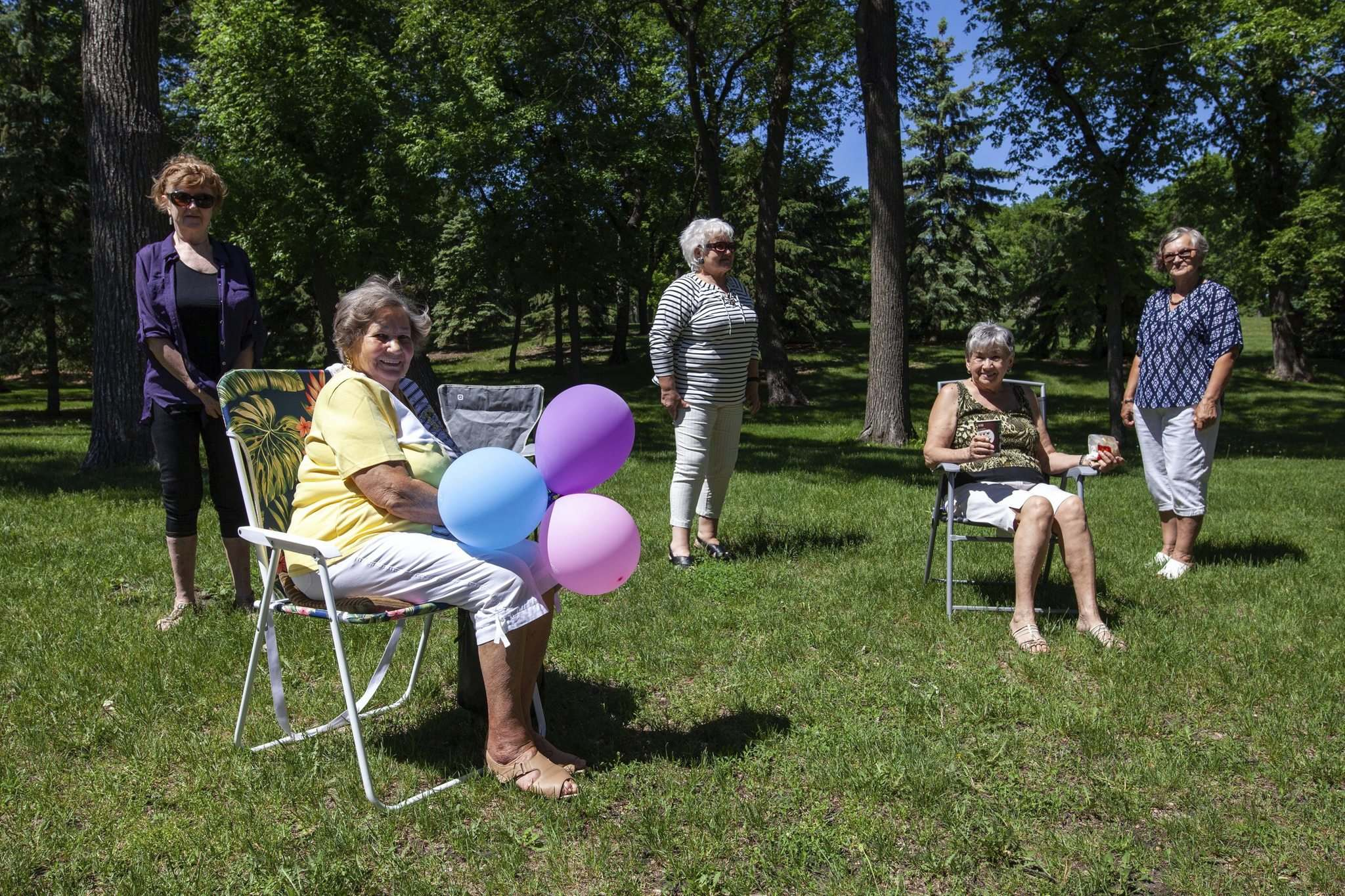 Tela Karadin has waited weeks to celebrate her 82 birthday together with a few friends. With the relaxed COVID-19 restrictions, the small group met at Kildonan Park on Saturday. (Daniel Crump / Winnipeg Free Press)</p>