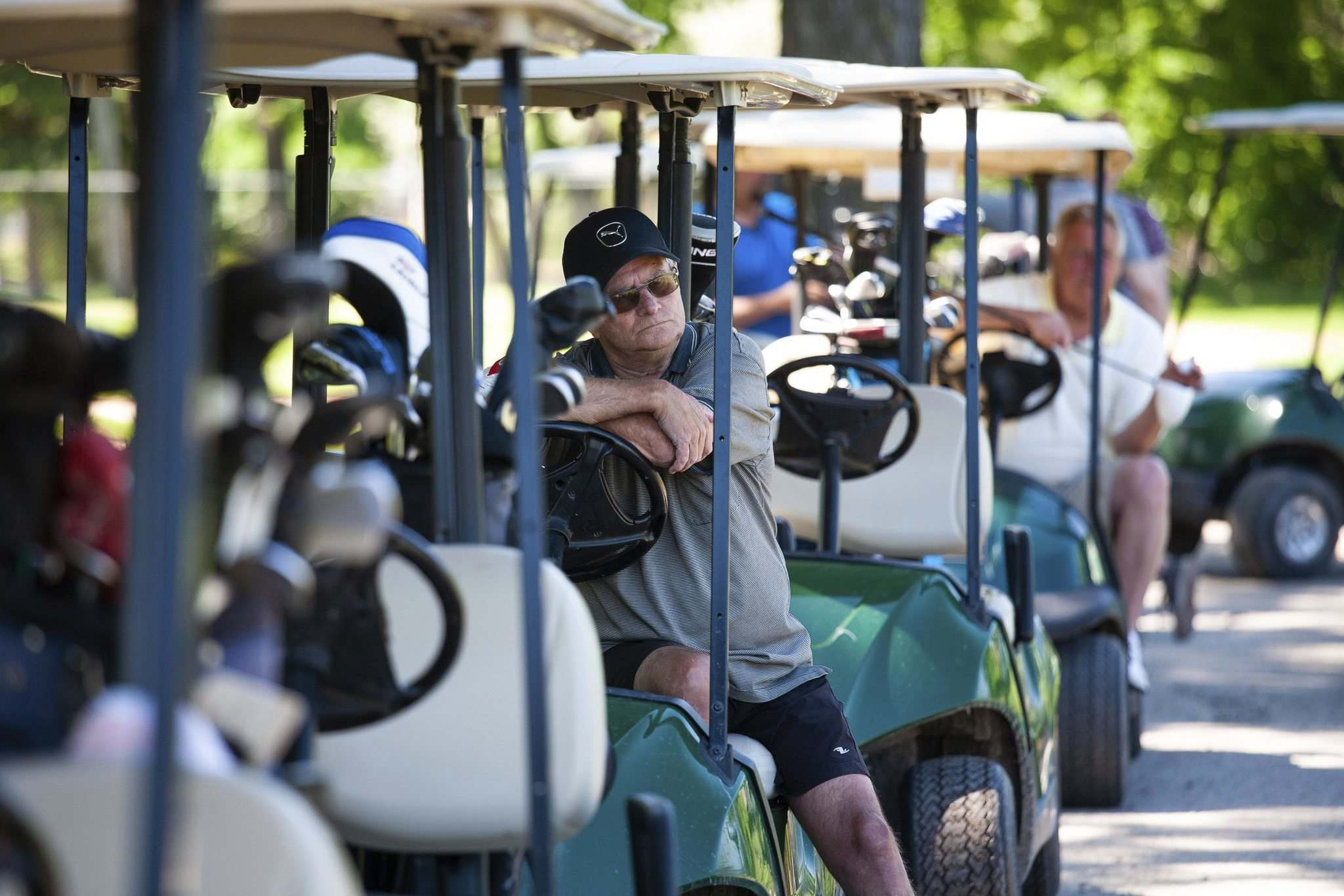 Robert Claywaits for his turn to tee off as he plays a round of golf with some friends at Kildonan Park golf course on Saturday afternoon.  (Daniel Crump / Winnipeg Free Press)</p>