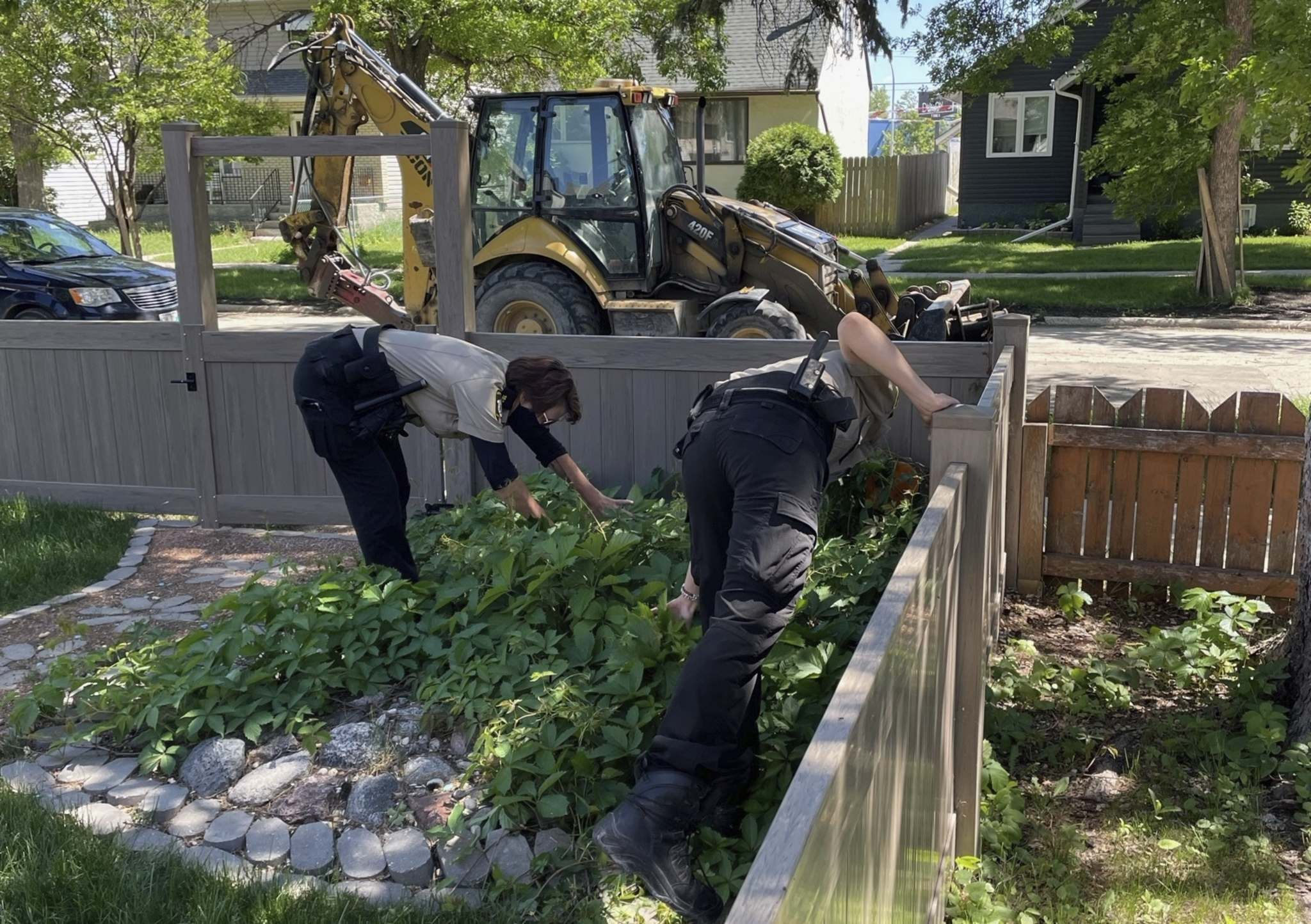 Breno Martins Photo</p><p>Animals Services staff search for a large snake on Ebby Avenue in Winnipeg on Saturday.</p>