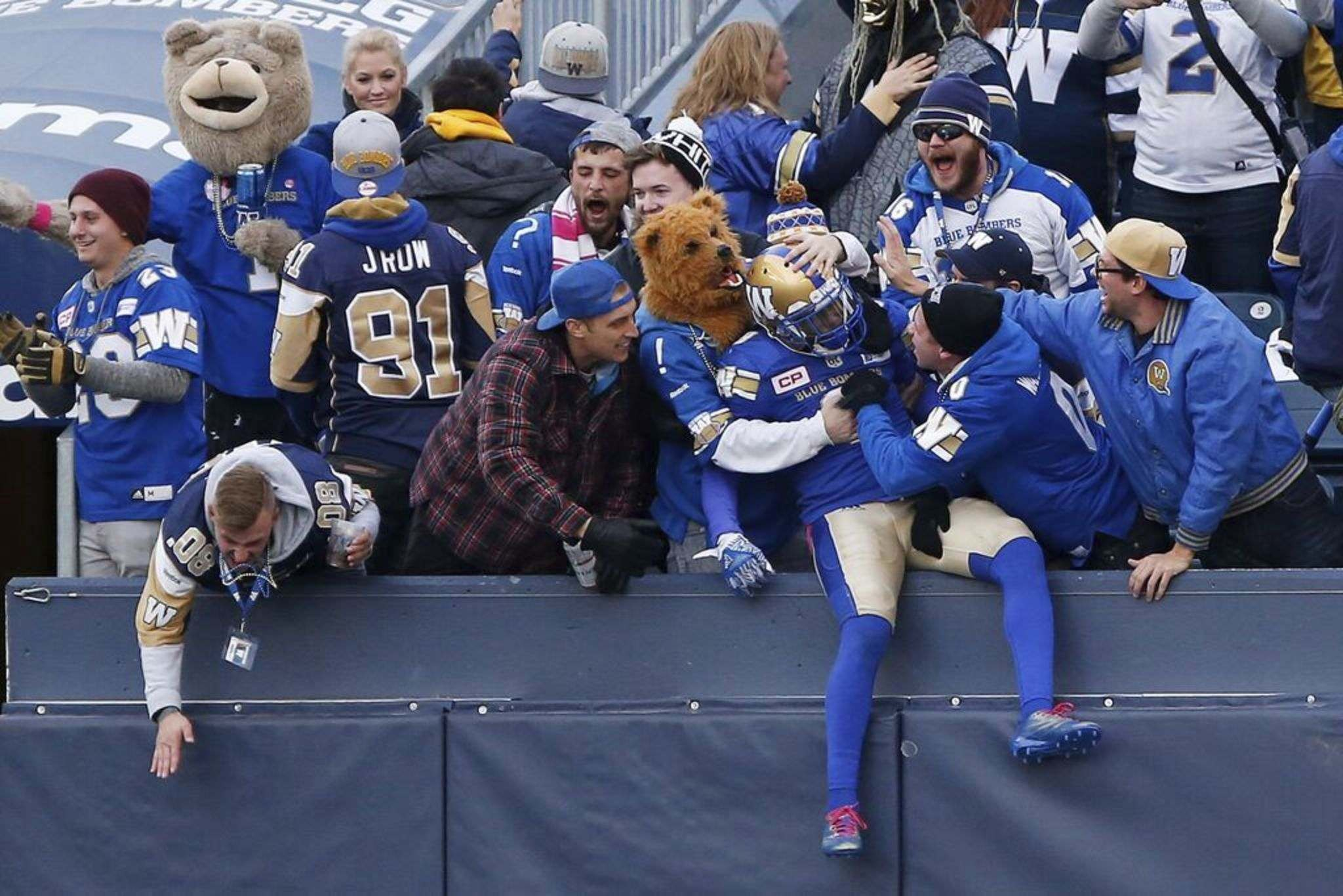 Winnipeg Blue Bombers' fans celebrate during CFL game action against the B.C. Lions, in Winnipeg in 2017. THE CANADIAN PRESS FILES/John Woods</p>