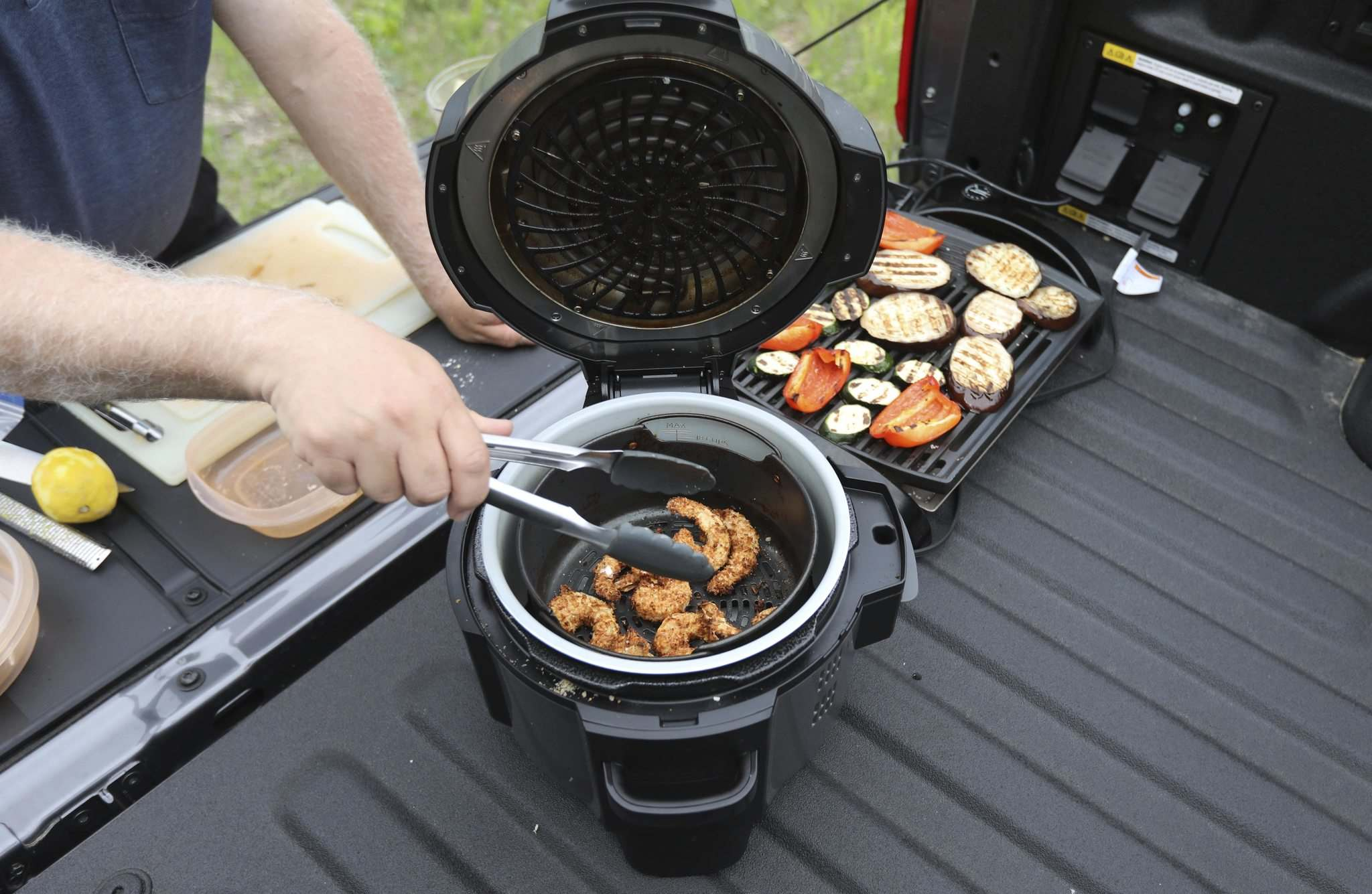 RUTH BONNEVILLE / WINNIPEG FREE PRESS</p><p>ENT - cooking with Ford F-150</p><p>Subject: F-150 PowerBoost Hybrid and lunch</p><p>Landing the F-150 on the food page by using the electric outlets located on the plate bed of the Electric truck to prepare lunch outside.</p><p>Details: Will be cooking lunch using the hybrid truck's 7.6-kW on-board power. Air-fryer coconut shrimp with mango chutney, grilled summer vegetable salad, air-fryer apple fritter for dessert, virgin strawberry margarita. Come hungry.</p><p>Photos of kitchen set up in the bed, the truck in its 'wild' surroundings, candids of Kelly cooking, as well as prepared food photos.Grilled veggies and coconut shrimp.</p><p>For the food page: Wed., June 23</p><p>June 16,, 2021</p></p>