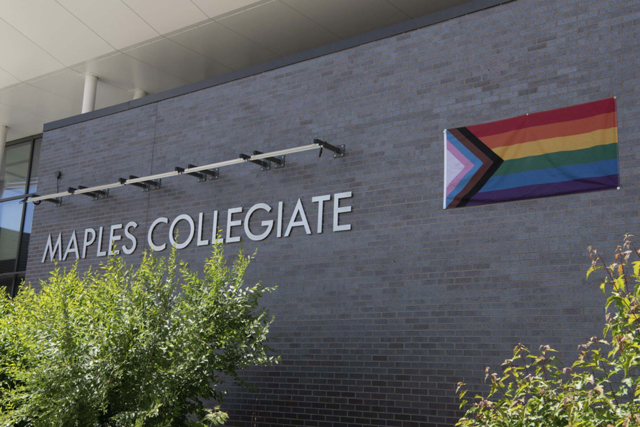A Pride flag was moved to the wall of Maples Collegiate in Winnipeg on Tuesday after receiving a note from the Seven Oaks School Division stating that it is against provincial and federal protocols to have the Canadian and Pride flags on one pole. (Alex Lupul / Winnipeg Free Press)</p>