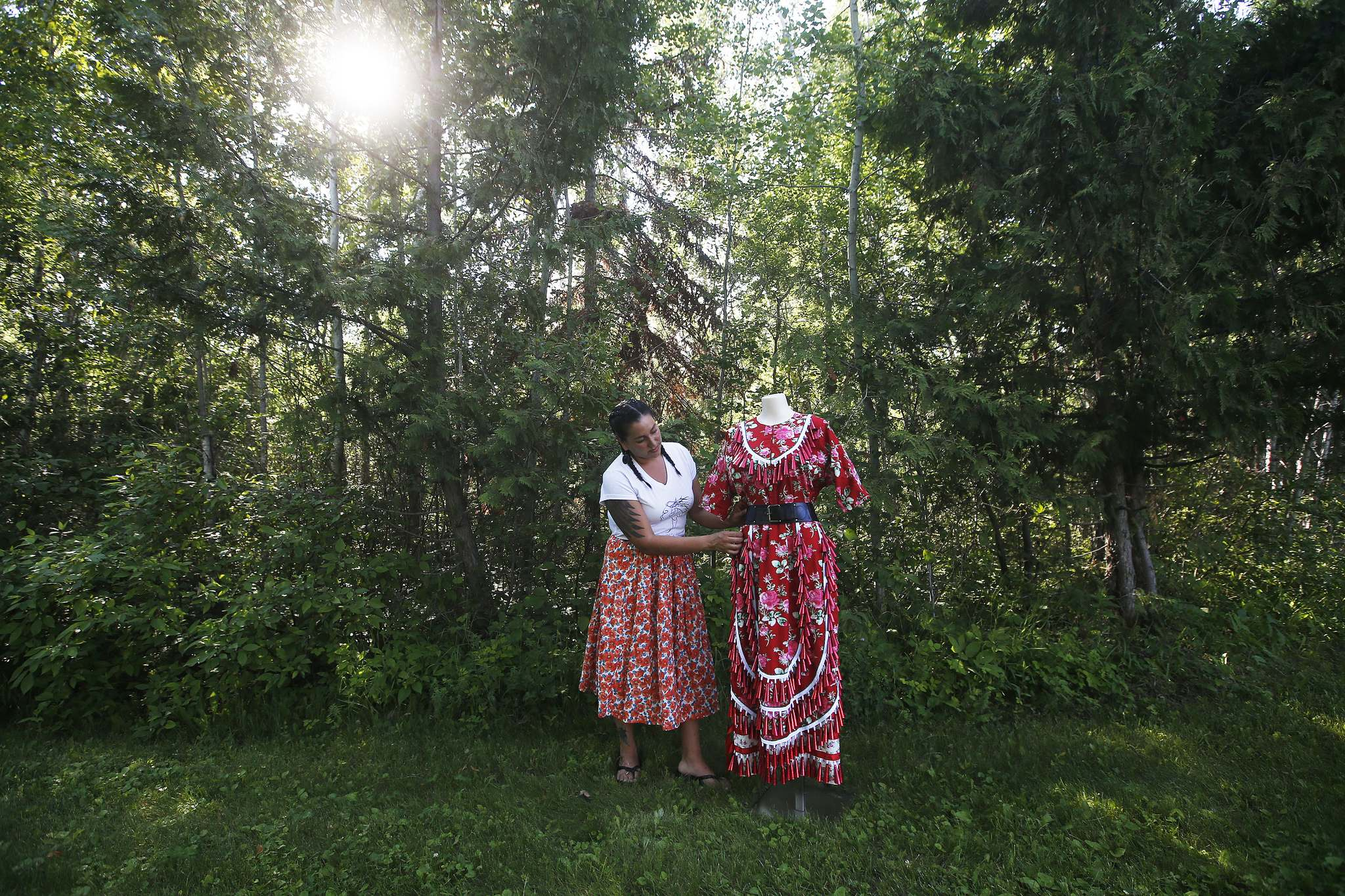 Wendy Sinclair of Pretty Windy Designs creates ponchos, blankets, skirts, vests and jackets, using fabrics and designs that are part of her culture. (John Woods / Winnipeg Free Press)</p></p>