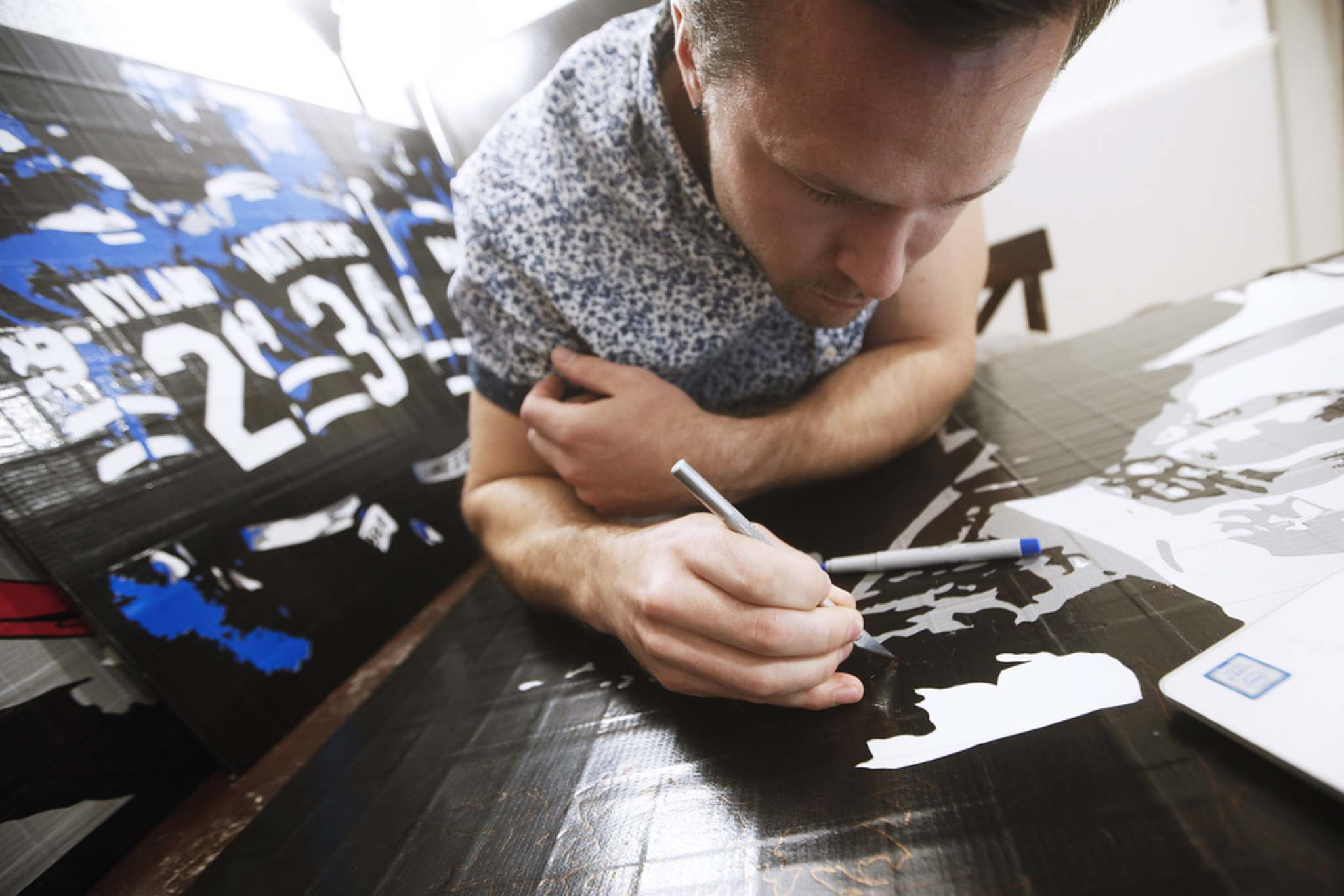 Levi Sobering, duct tape artist and founder of Duct Tape Dynasty, a home-based business that produces duct-tape art, works on a new piece in his home in Winnipeg.</p>