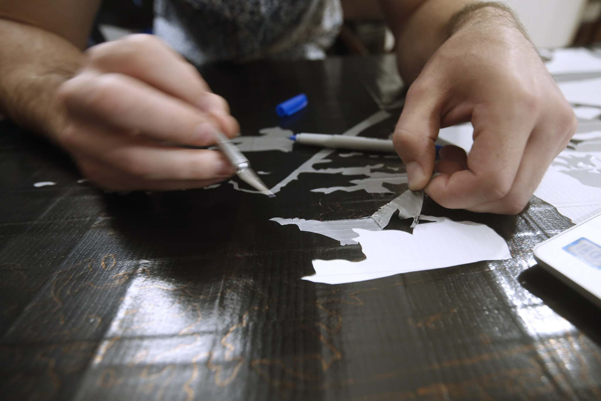 Sobering uses an X-Acto crafting knife to carefully slice through the coats of tape until he reaches the colour he's after. He then peels back the tape he's cut through, removing it with the help of his knife to create a two-dimensional look.</p>