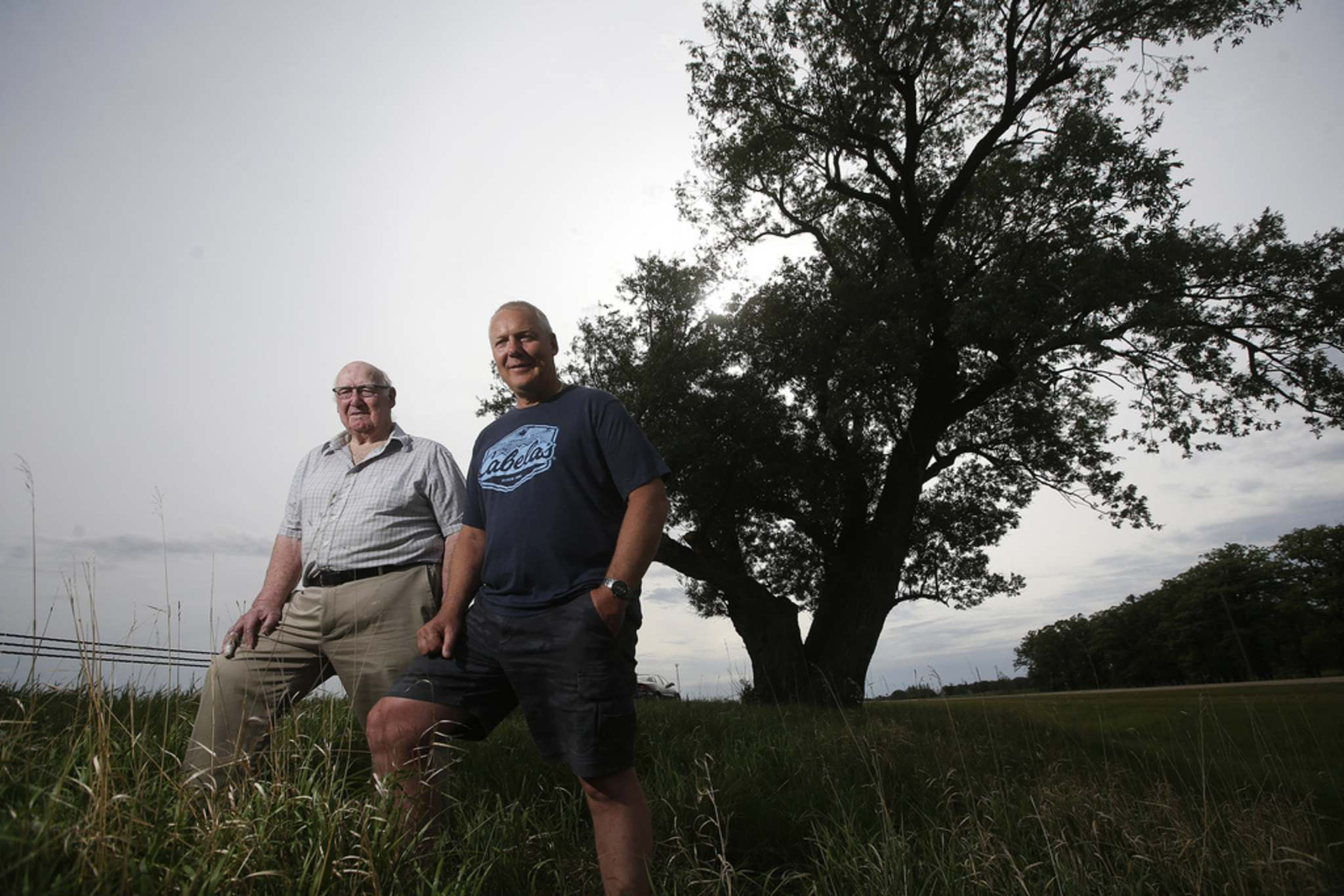 JOHN WOODS / WINNIPEG FREE PRESS</p><p>Donald Coubrough's grandfather, Walter Smith, planted two willows on their property circa 1872. He and his son Kevin recently visited the surviving North Tree, which is a Manitoba heritage tree.</p>