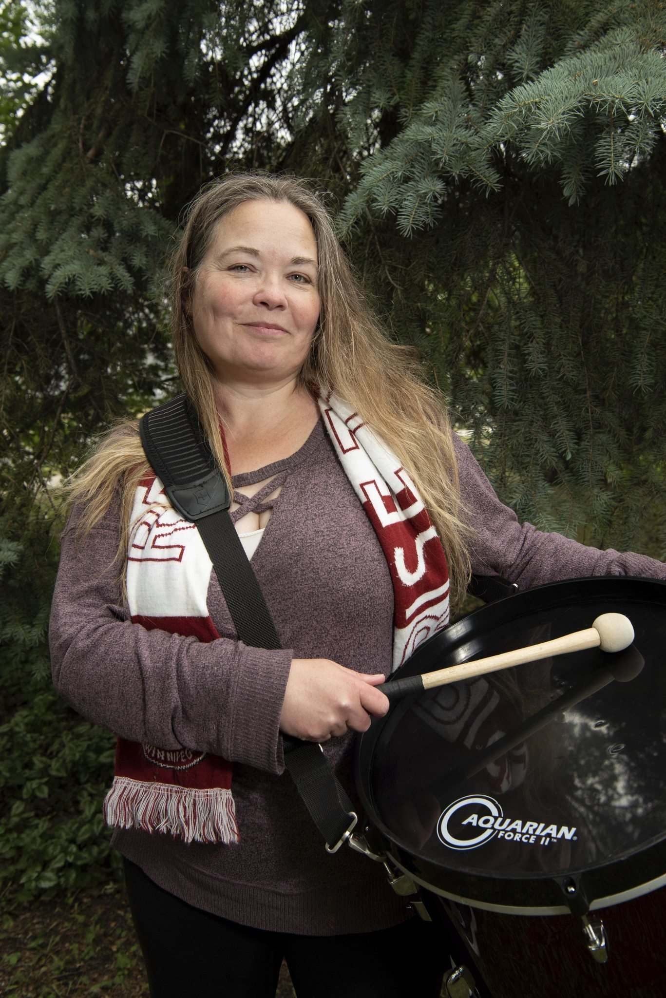 Nicky Cottee and members of the Red River Rising have stood outside Gate 2 at IG Field to watch the game on the big screen and sing and cheer for the club. (Alex Lupul / Winnipeg Free Press)