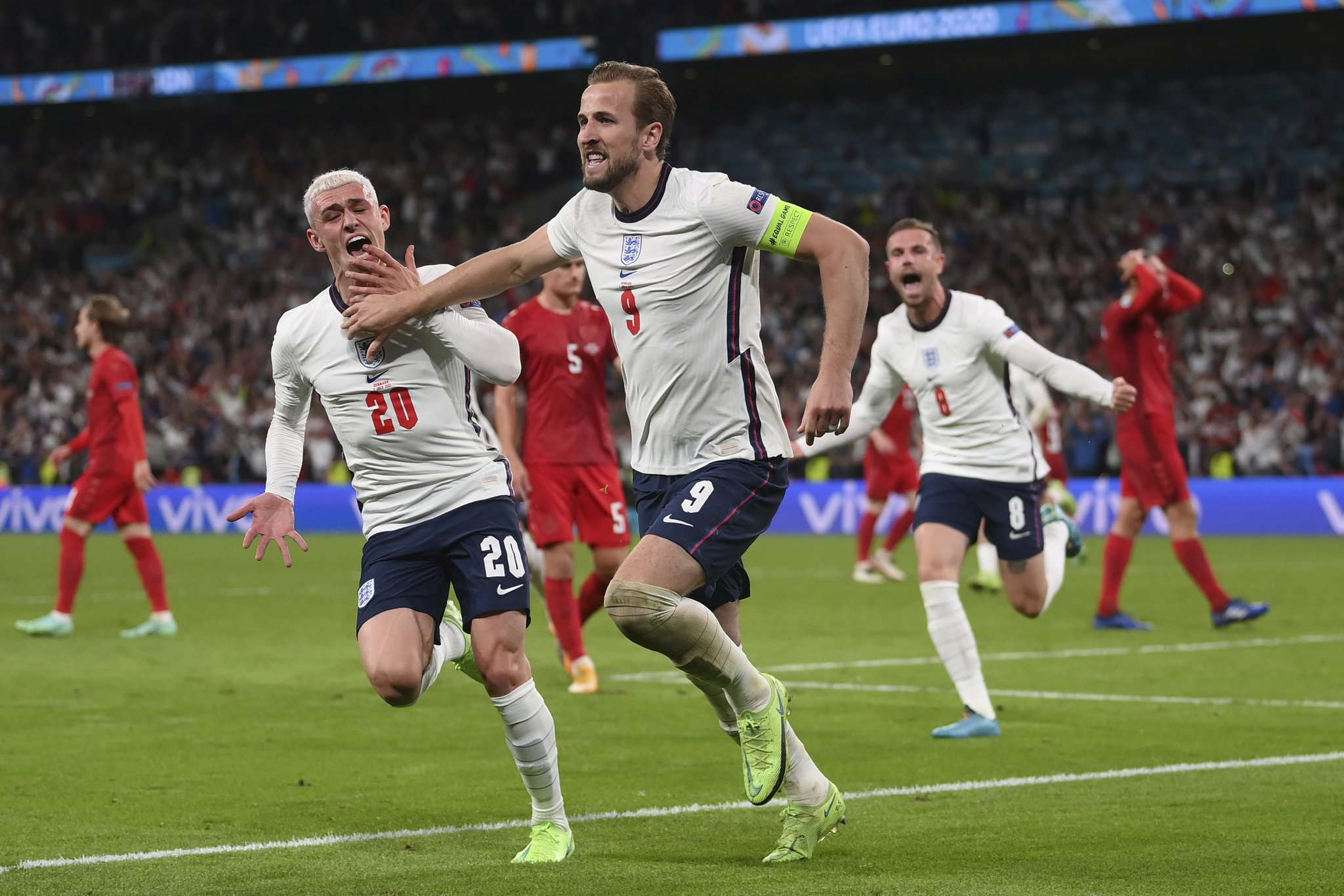 England's Harry Kane, right, celebrates with his teammates after scoring his side's second goal during the Euro 2020 soccer semifinal match between England and Denmark at Wembley stadium in London, Wednesday.