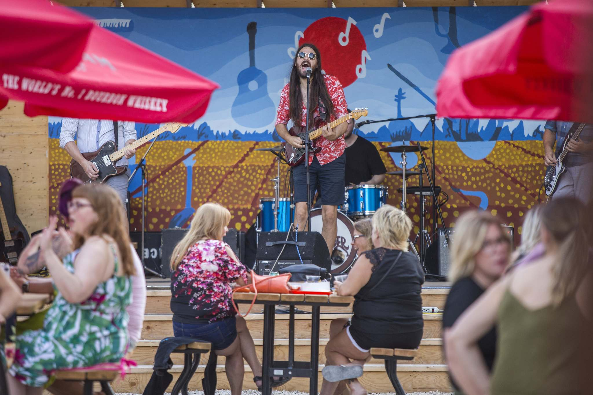 Bobby Desjarlais sings as his band, Bullrider, plays to a packed house at Blue Note Park in Winnipeg. (Mikaela MacKenzie / Winnipeg Free Press)