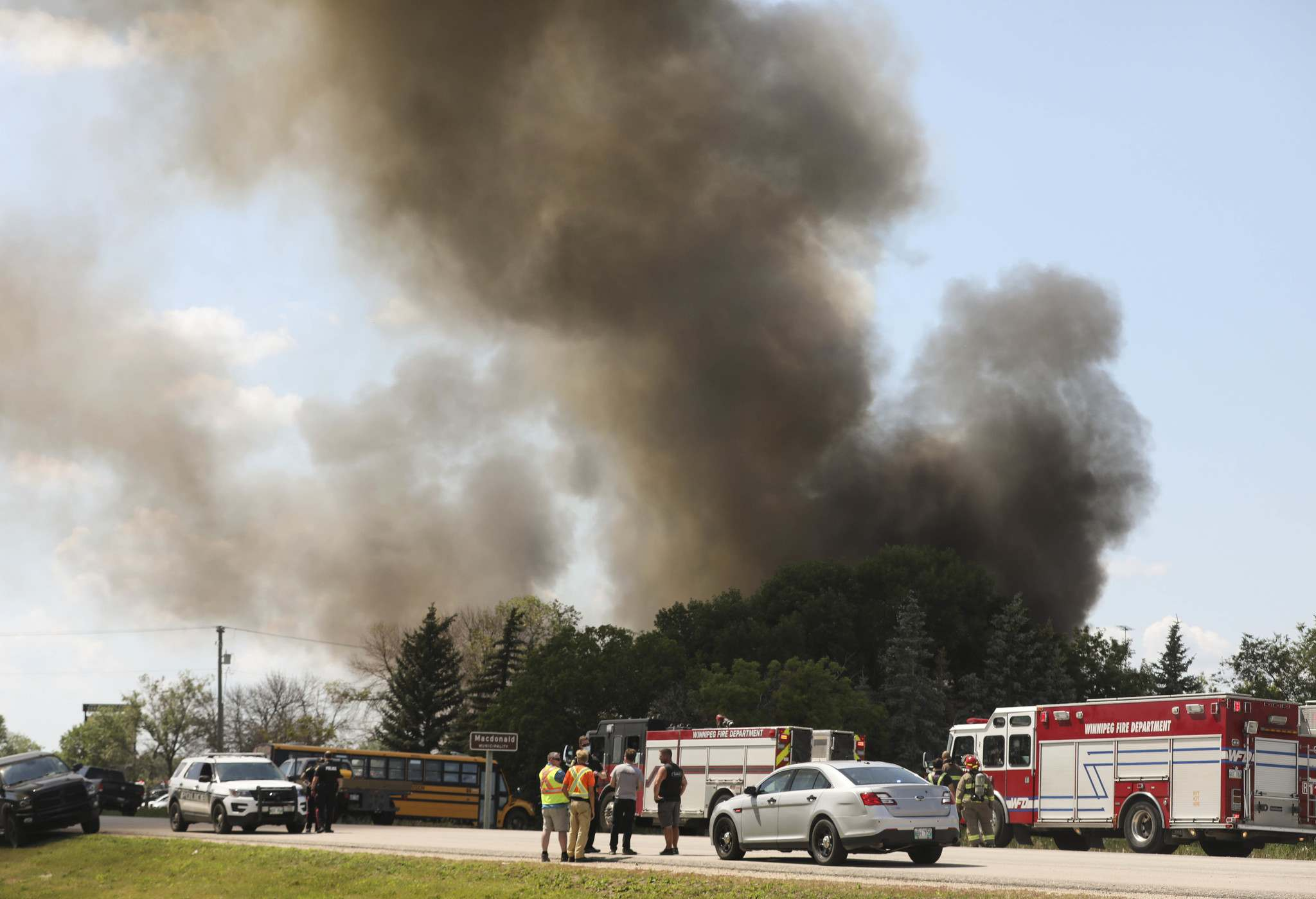 """The WFPS spokesperson said due to a high volume of 911 calls about the fire, a """"WFPS executive"""" decided to send resources to the scene at 2:03 p.m."""
