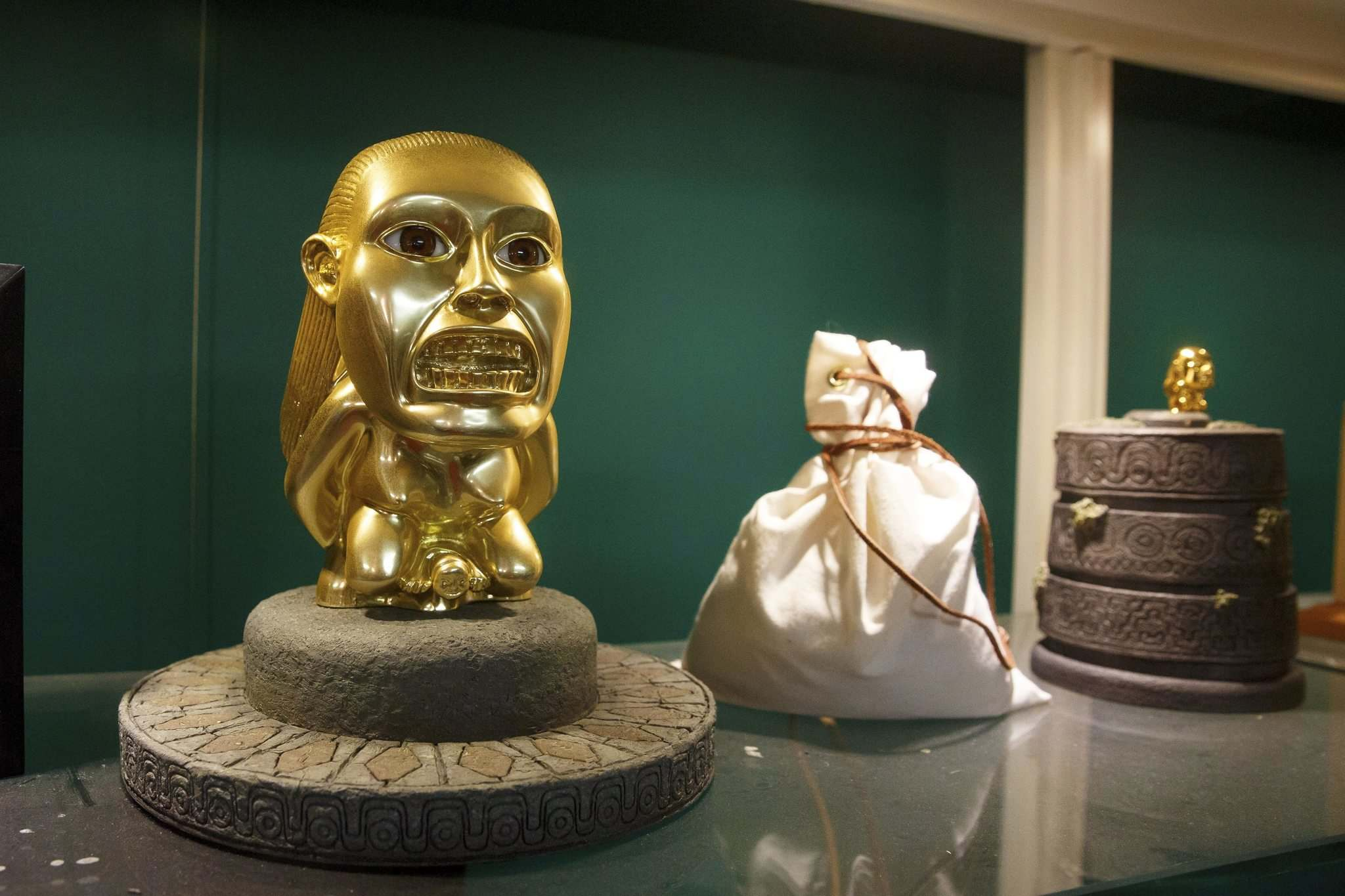 A replica of the idol and bag of sand from the first movie, Raiders of the Lost Ark. Interesting note is that this replica has the open eyes that were supposed to be on the one in the movie. The idol in the movie had eyes that opened mysteriously, but when they didn't work it was decided to continue with the shoot, so, most replicas show the eyes closed.</p>