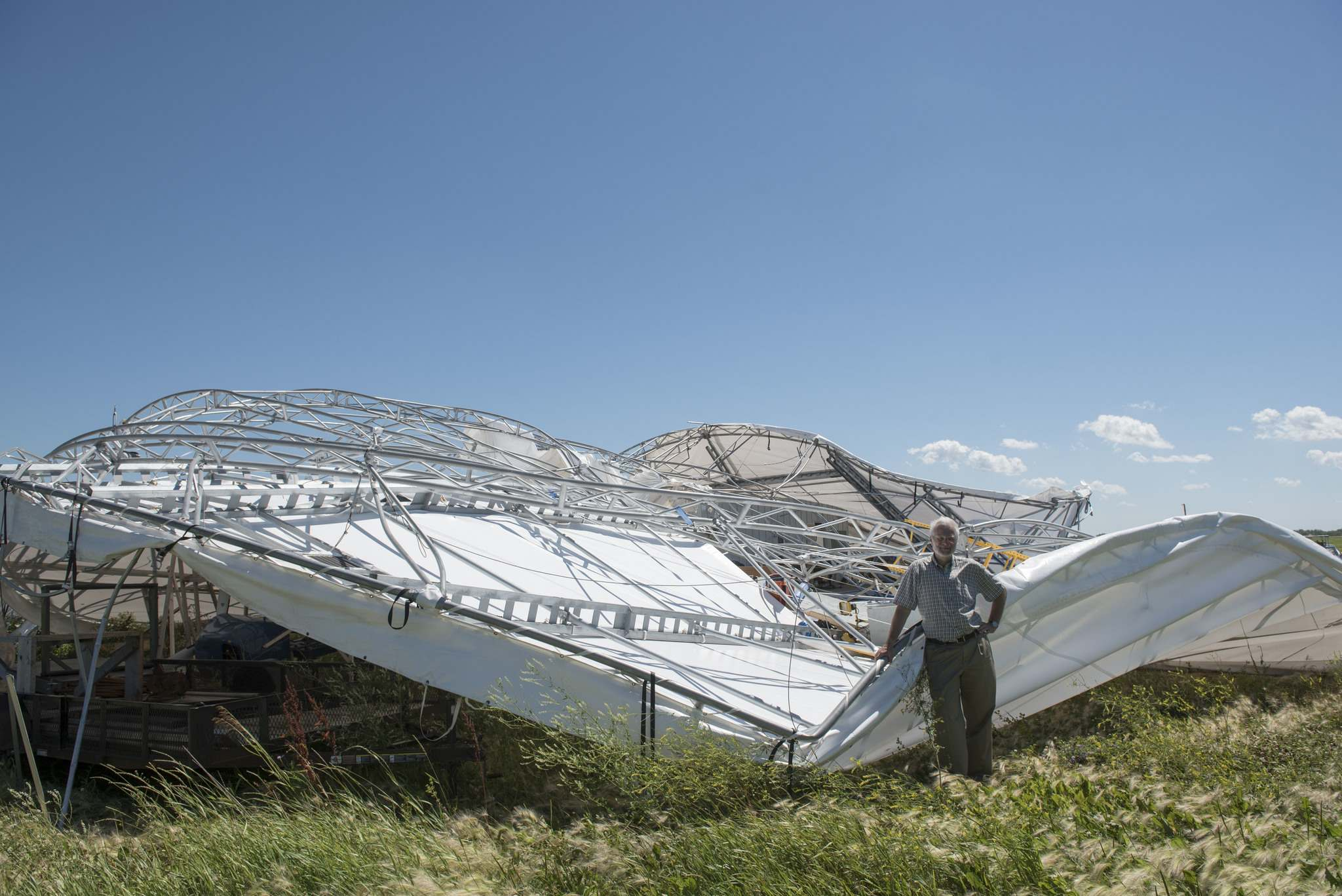 DAVID LIPNOWSKI / WINNIPEG FREE PRESS Files</p><p>Barry Prentice surveys damage caused by a windstorm at St. Andrews Airport in July 2016. Prentice's small hangar and research operation at the airport was wiped out by the storm.</p></p>