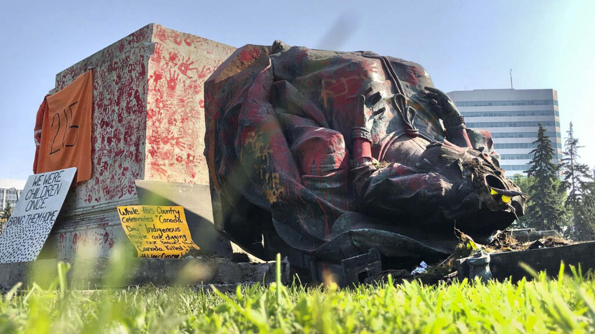 <p>The statue of Queen Victoria lays on the front lawn of the Manitoba Legislative Building after being toppled off its base on Canada Day.</p>