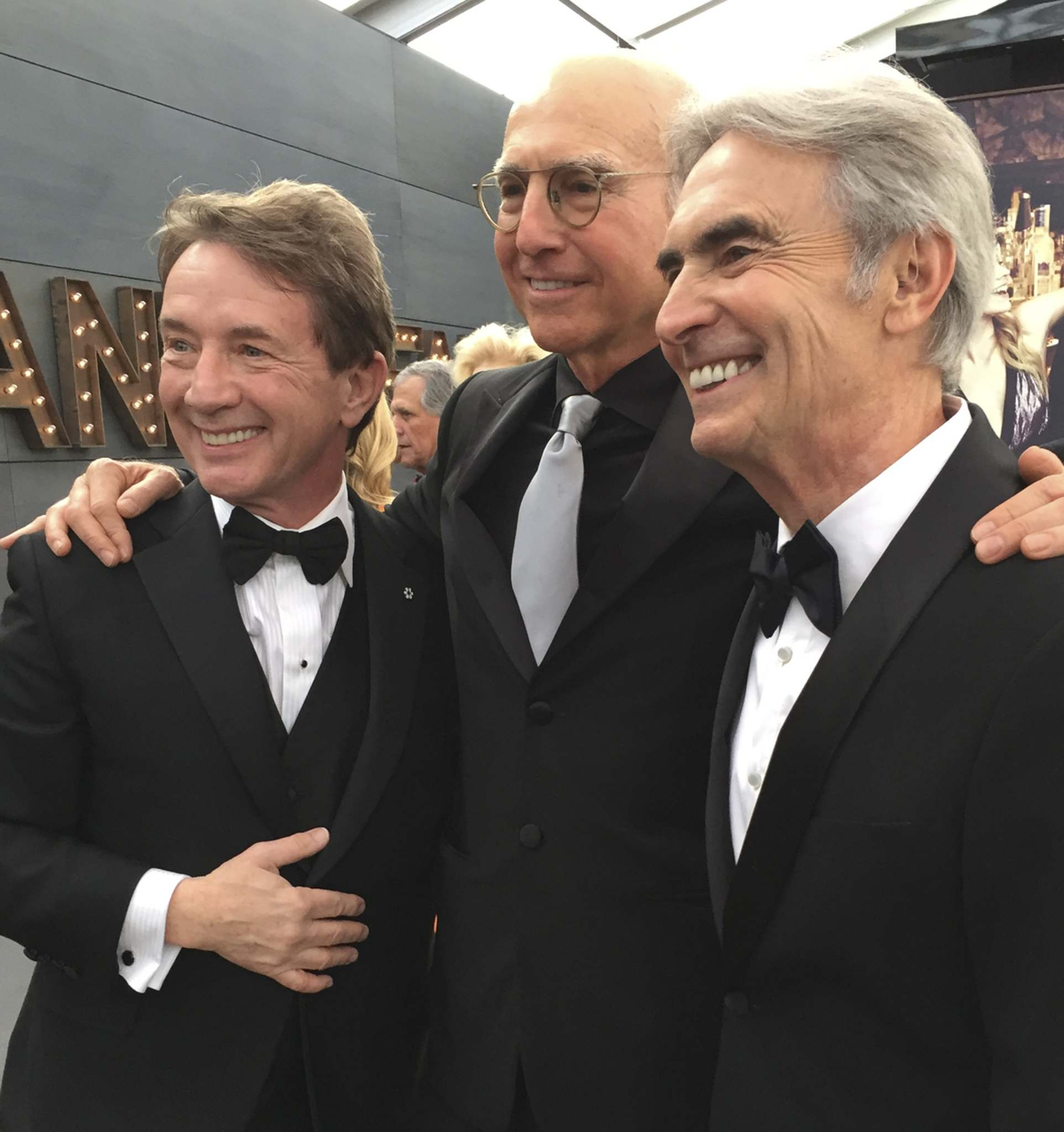 Martin Short (left) and Larry David (centre), seen here with Steinberg at the Vanity Fair Oscar party in 2016, are just two of the many comedic legends profiled in Inside Comedy.</p>