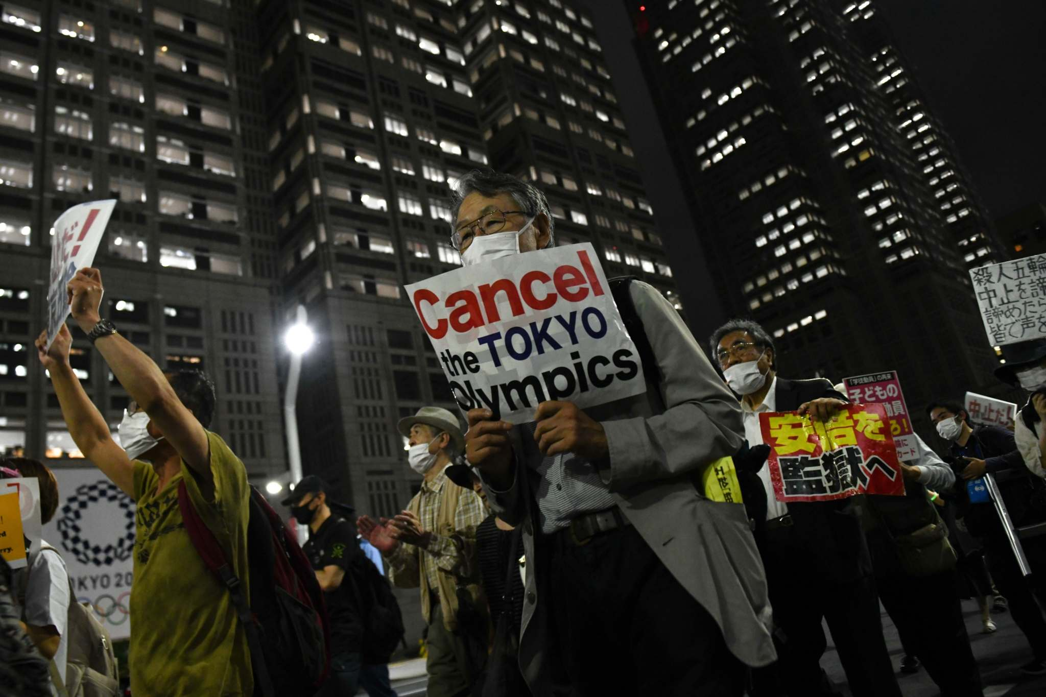 Noriko Hayashi / Bloomberg</p><p>Protesters in Tokyo call for cancellation of the Olympics.</p>