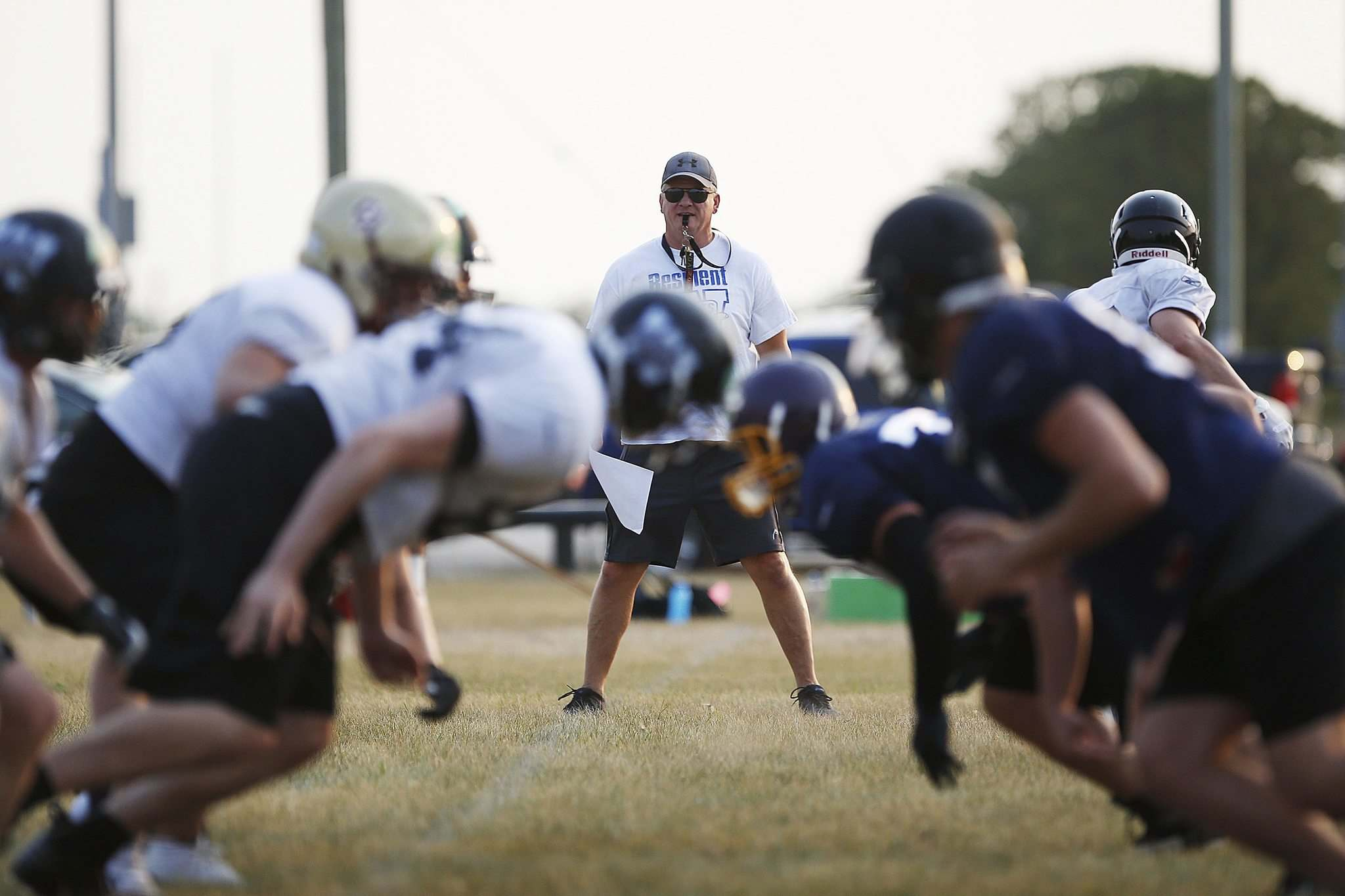 John Woods / Winnipeg Free Press </p></p><p>The Winnipeg Rifles practise while head coach Geordie Wilson looks on Monday. The CJFL team was able to start training camp wrokouts at the end of June. </p>