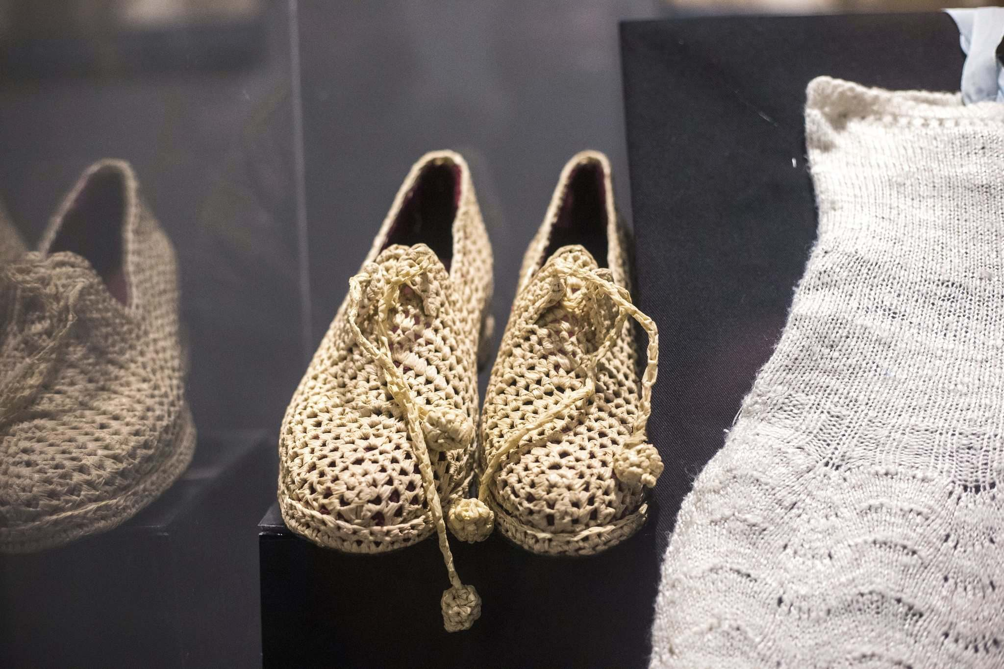 Homemade shoes (likely made of straw) are part of the Mennonites at War exhibition, which contains many donated items. (Mikaela MacKenzie / Winnipeg Free Press)</p>