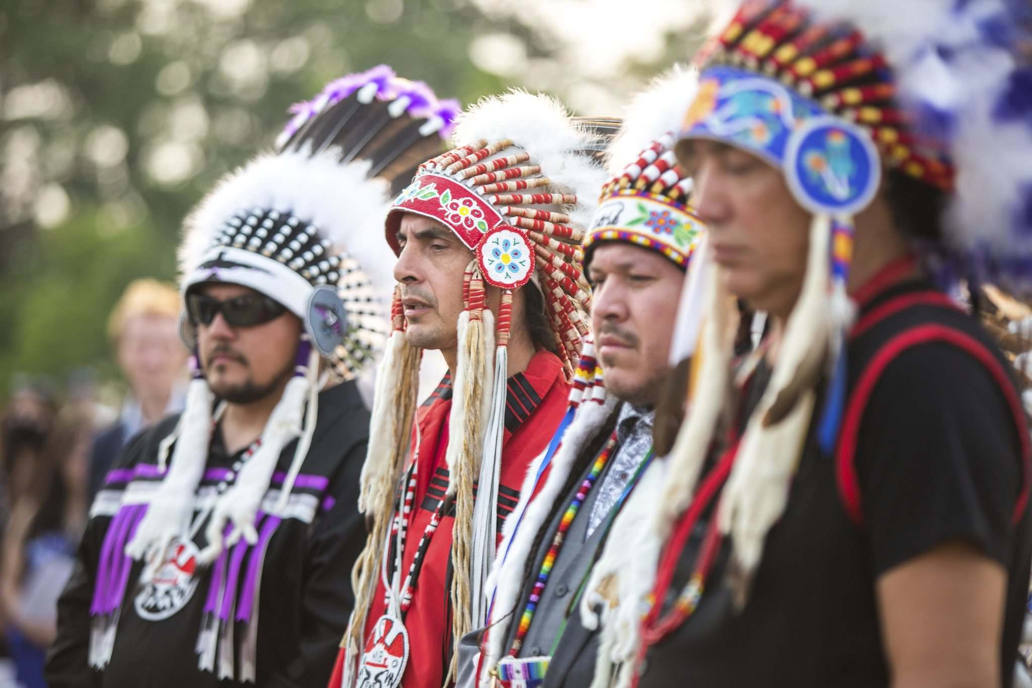 MIKAELA MACKENZIE / WINNIPEG FREE PRESS</p><p>Assembly of Manitoba Chiefs Grand Chief Arlen Dumas (second from left) and other Treaty No. 1 chiefs listen to the Spirit Sands Singers.</p>