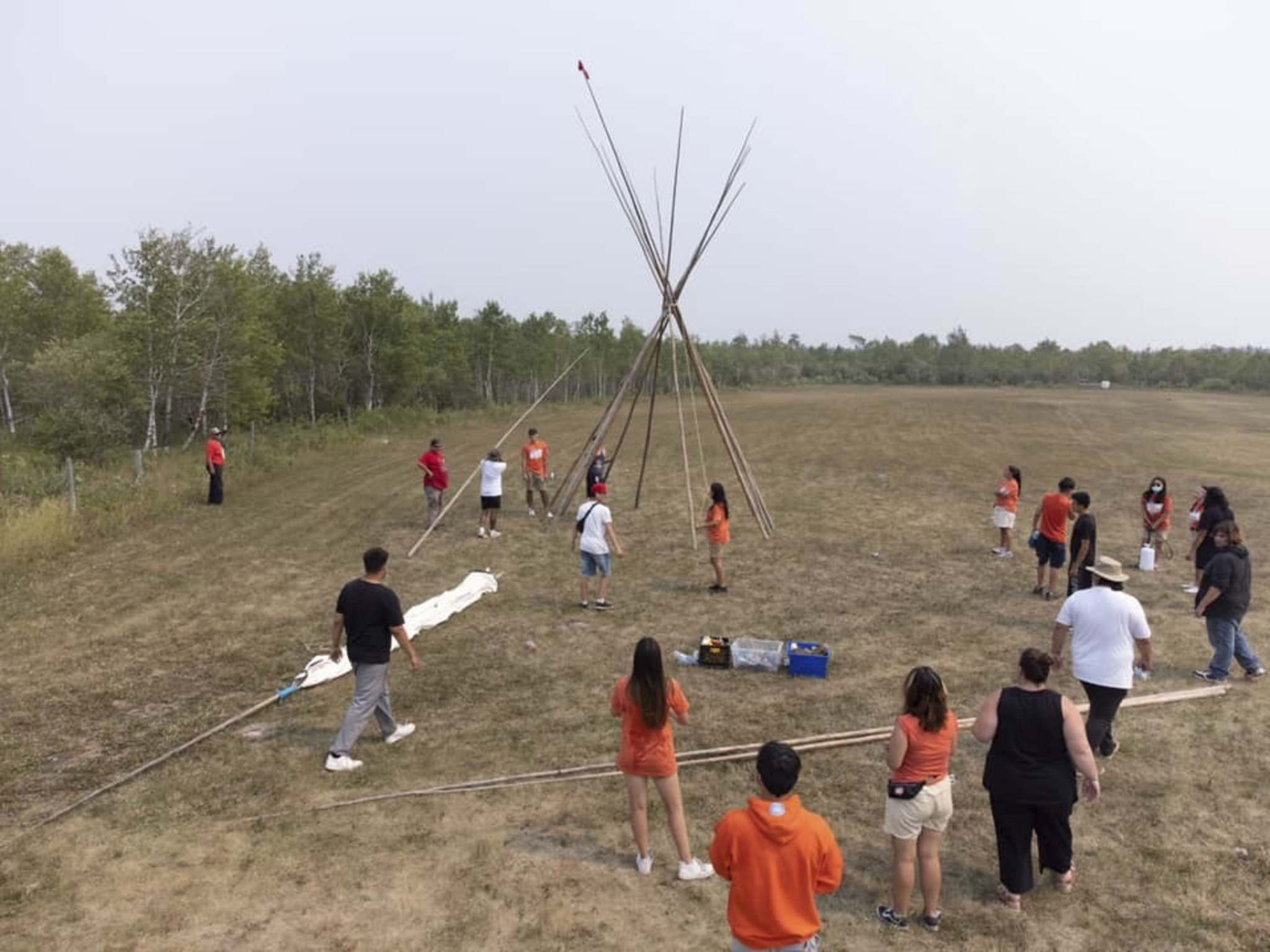 Anishiative campers built teepees together on the first day. (Supplied)</p>
