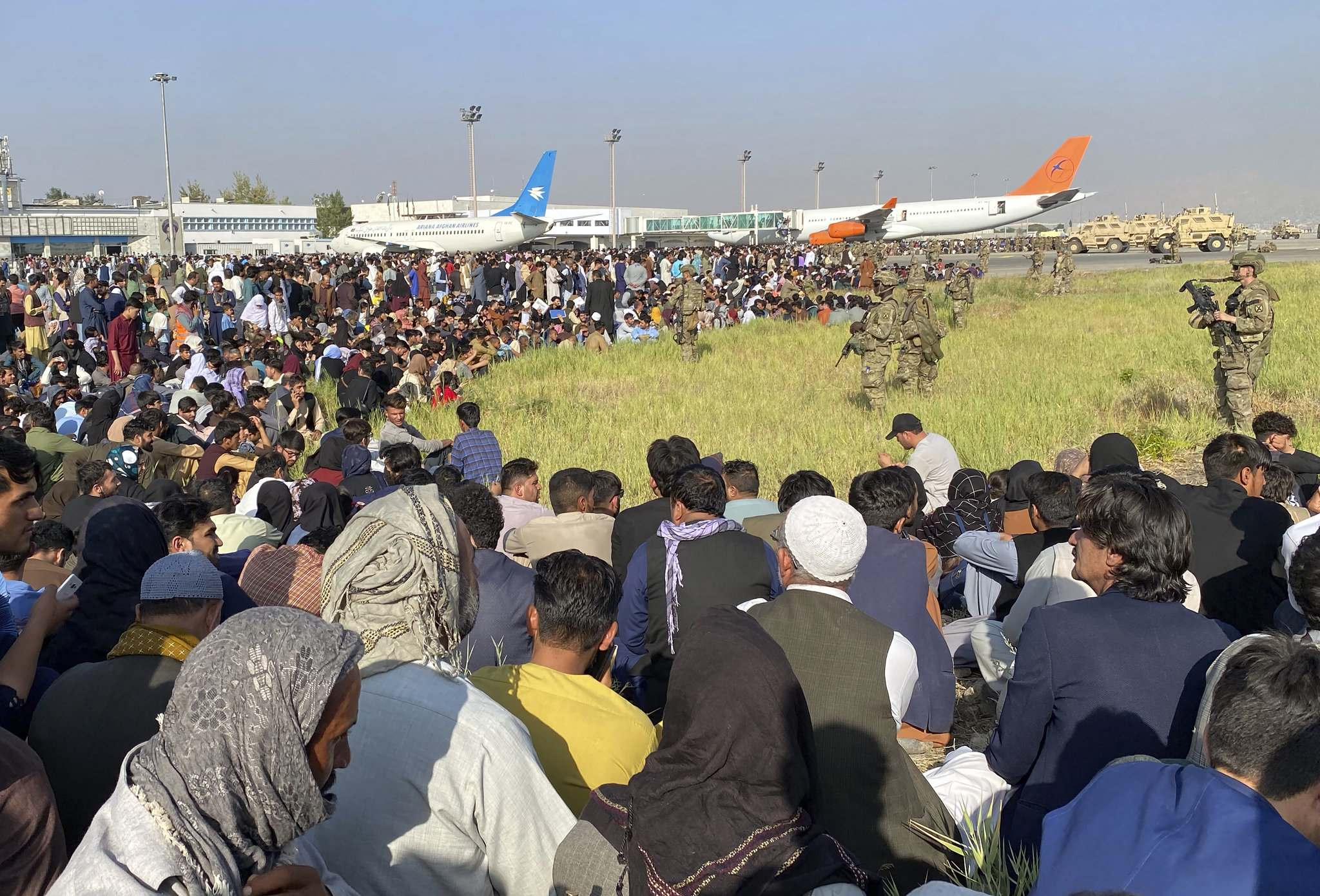 At the Kabul airport, thousands of Afghans are desperate to leave as the Taliban encircles the city.</p></p>