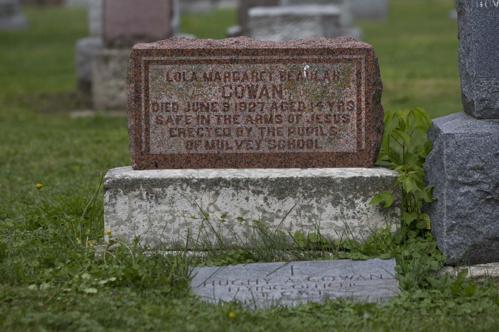 Photos by RUTH BONNEVILLE / WINNIPEG FREE PRESS</p><p>The gravestone of Lola Cowan was erected thanks to money raised by pupils of Mulvey School. The 14-year-old was a victim of the Dark Strangler.</p></p>